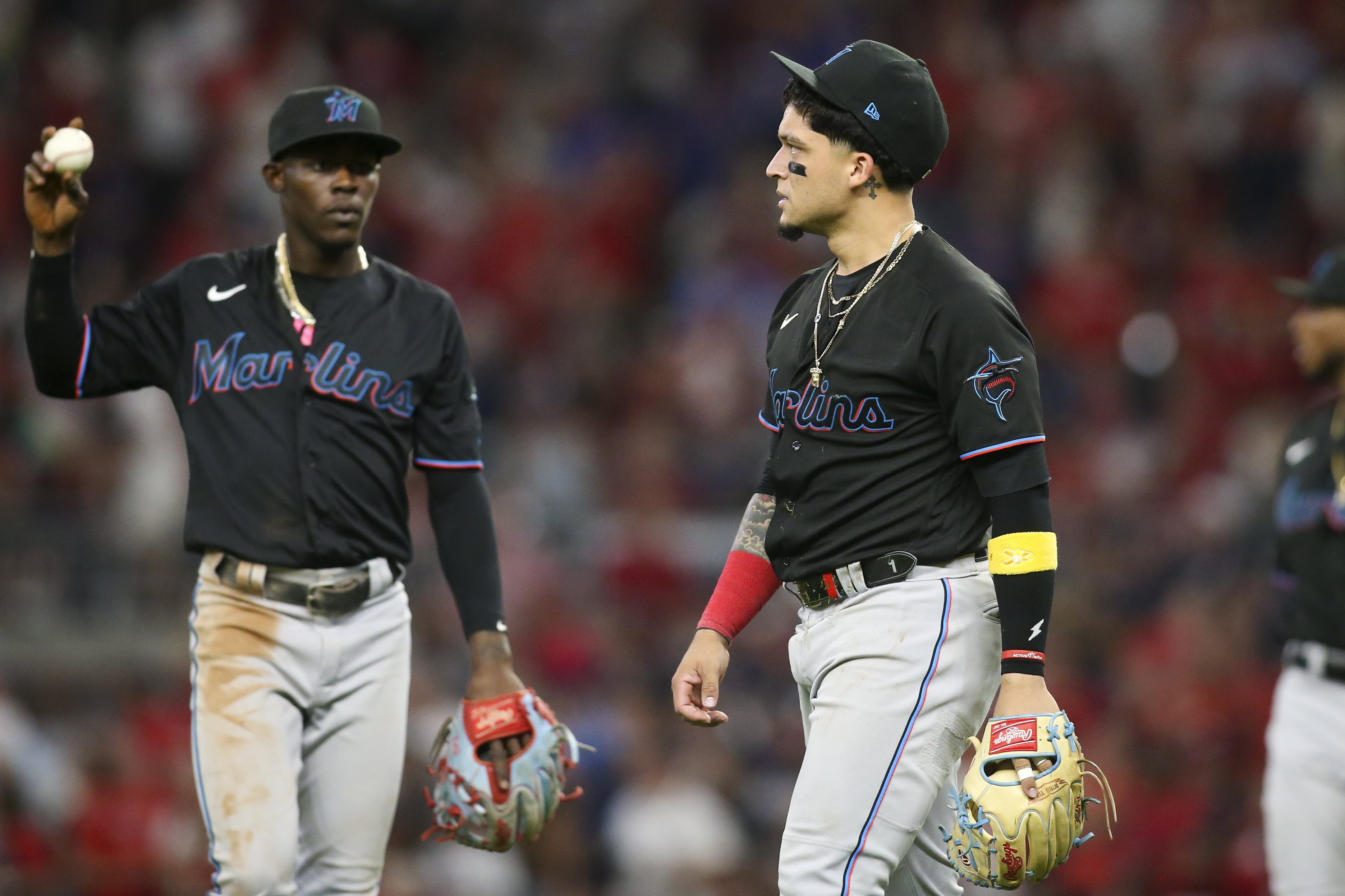 Miami Marlins second baseman Isan Diaz (1) reacts after an error as second baseman Jazz Chisholm Jr. (2) looks on against the Atlanta Braves in the fifth inning at Truist Park