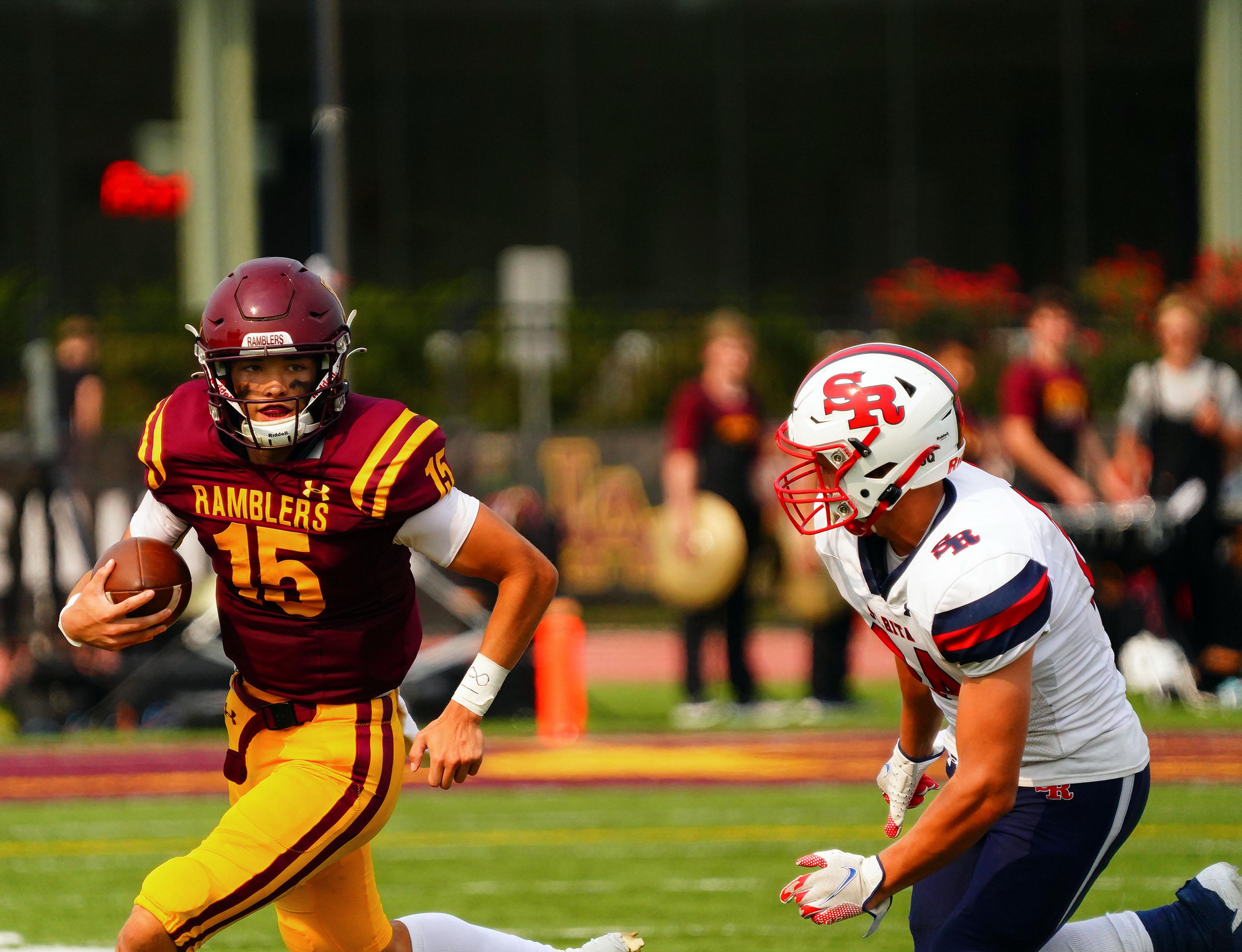 Loyola's Jake Stearney (15) scrambles away from St. Rita's Jake Lehtinen (24).