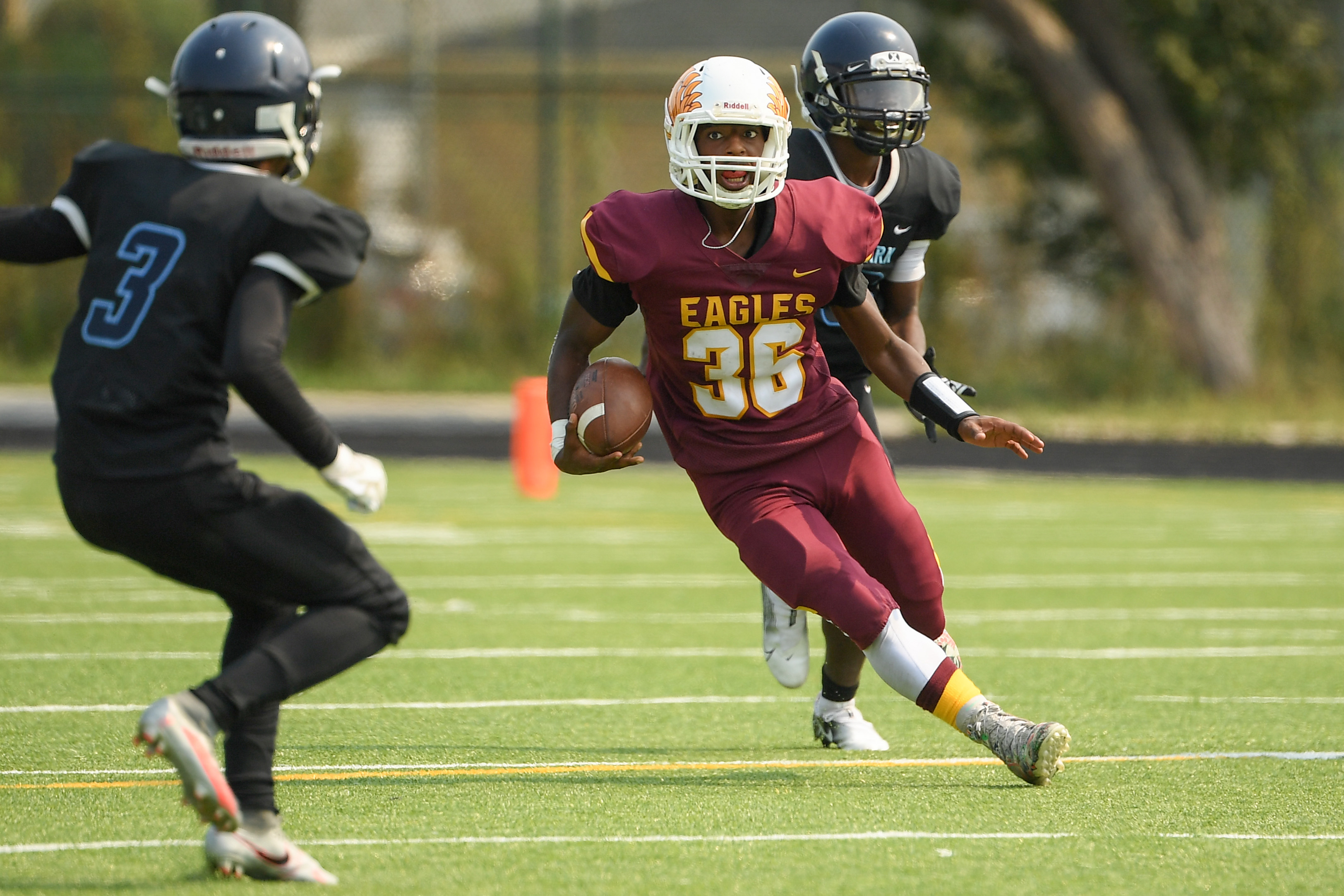 Lindblom running back Donovan Redmond rushes for a first down against Hyde Park.