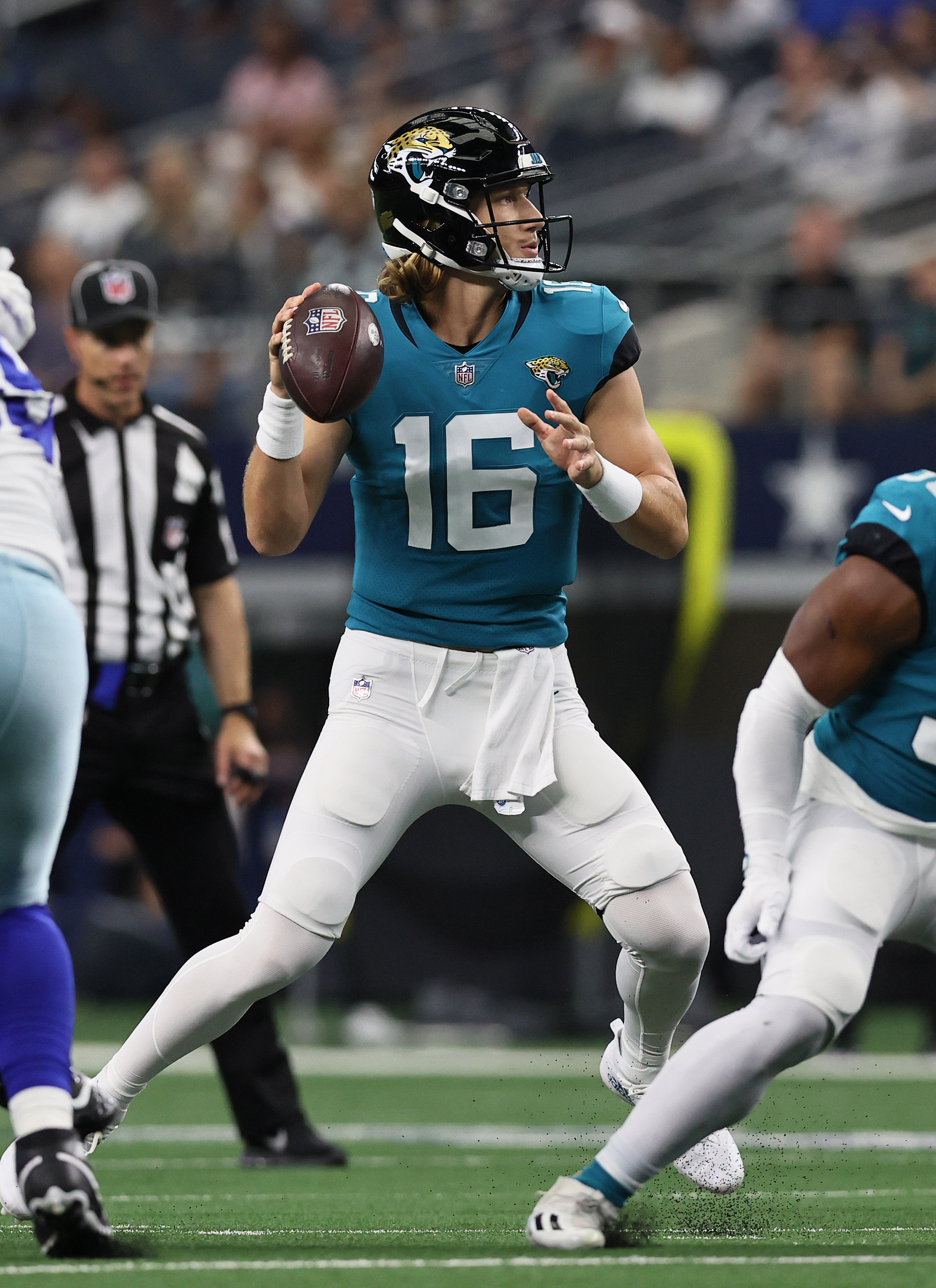 Jacksonville Jaguars quarterback Trevor Lawrence (16) throws in the pocket for a touchdown in the first quarter against the Dallas Cowboys at ATandT Stadium.