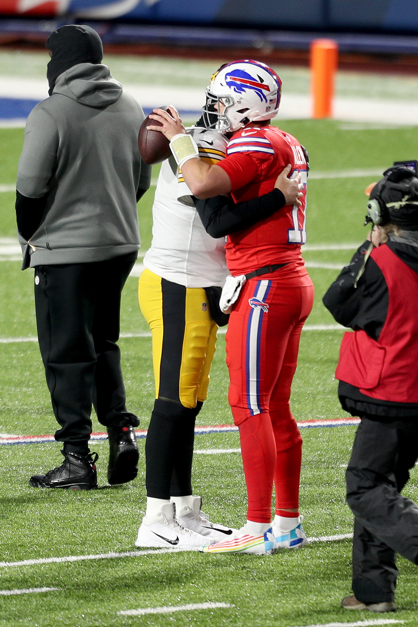 Ben Roethlisberger #7 of the Pittsburgh Steelers and Josh Allen #17 of the Buffalo Bills embrace after the Bills defeated the Steelers 26-15 at Bills Stadium on December 13, 2020 in Orchard Park, New York.