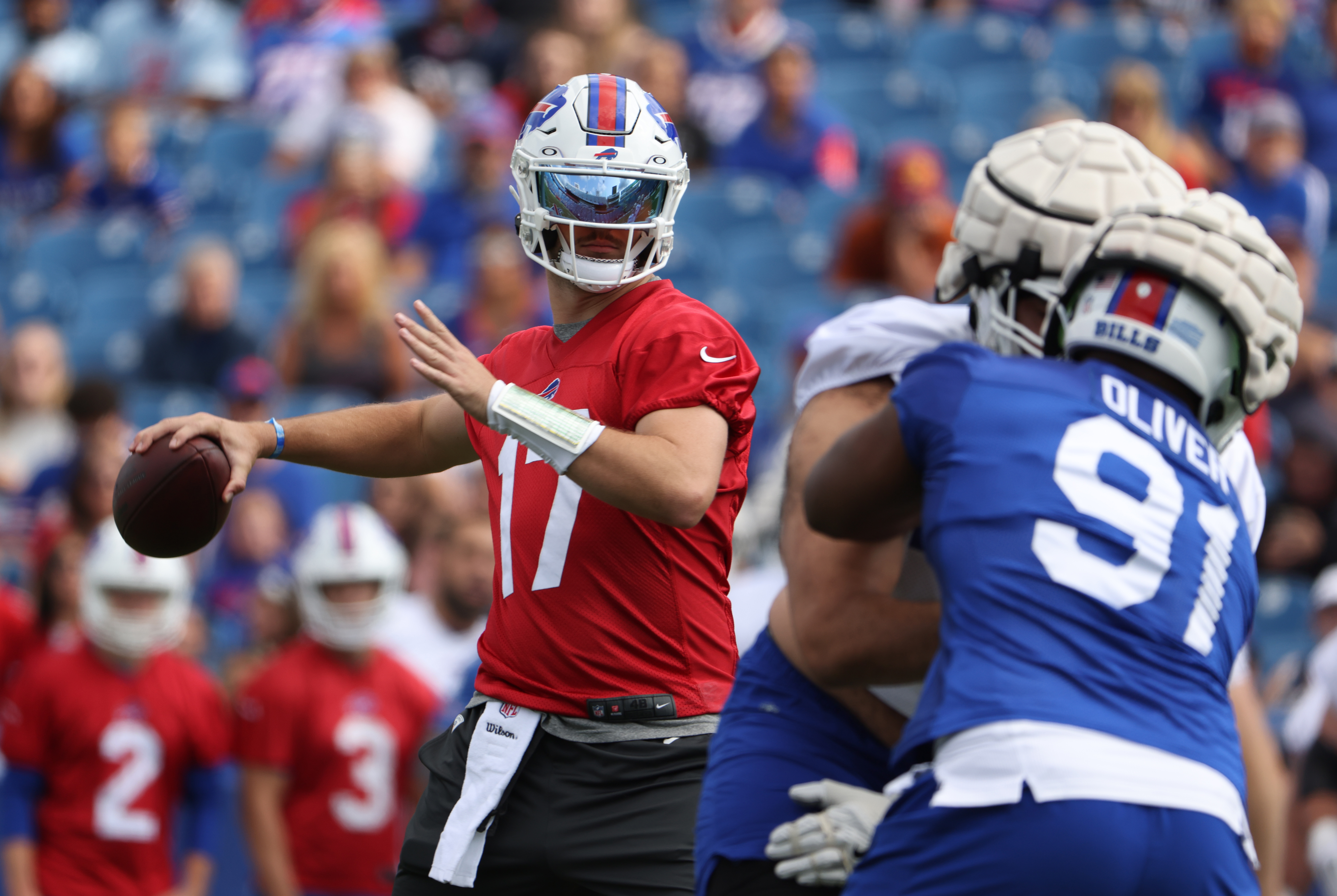 Josh Allen #17 of the Buffalo Bills drops back to throw a pass during training camp at Highmark Stadium on July 31, 2021 in Orchard Park, New York.