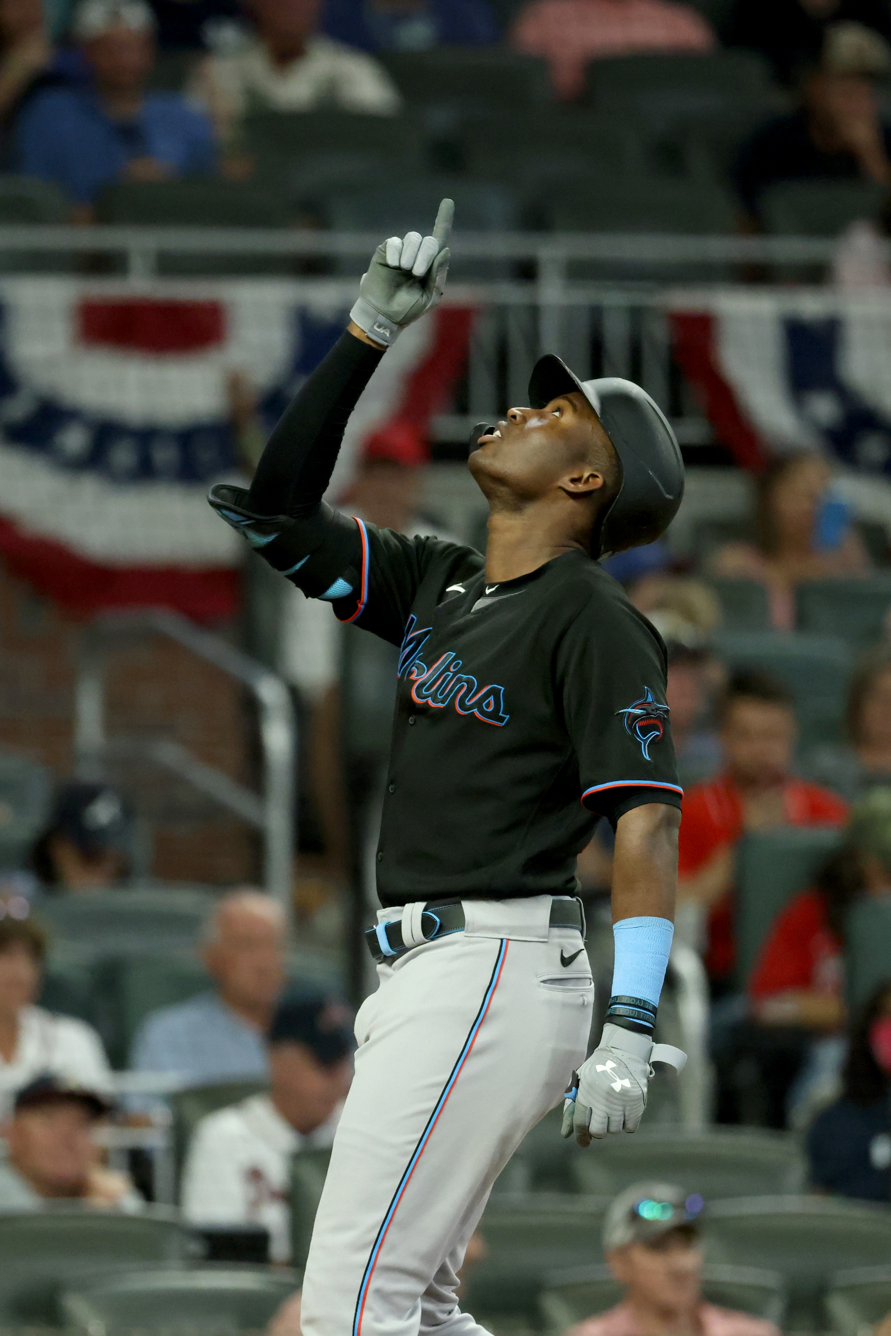 Miami Marlins outfielder Jesus Sanchez reacts after he hit a solo home run during the eighth inning against the Atlanta Braves at Truist Park