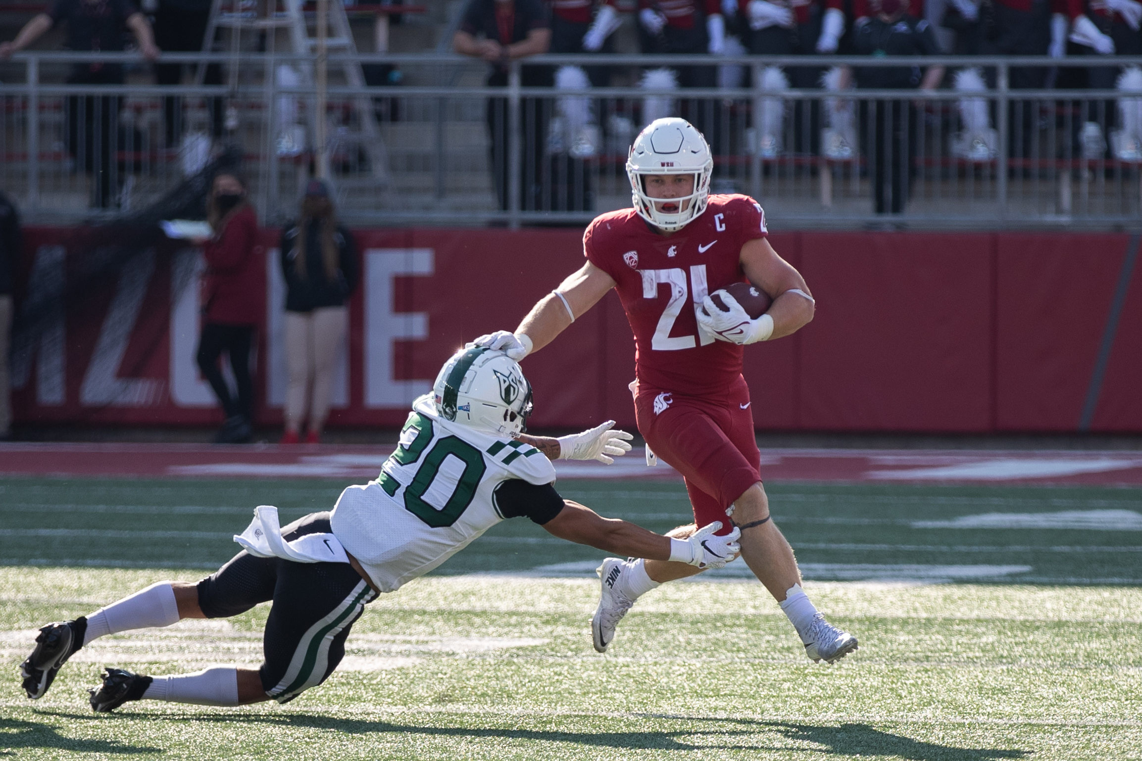 PULLMAN, WA - SEPTEMBER 11: Washington State running back Max Borghi (21) pushes down a defender during the first half of a non-conference matchup between the Portland State Vikings and the Washington State Cougars on September 11, 2021, at Martin Stadium in Pullman, WA.