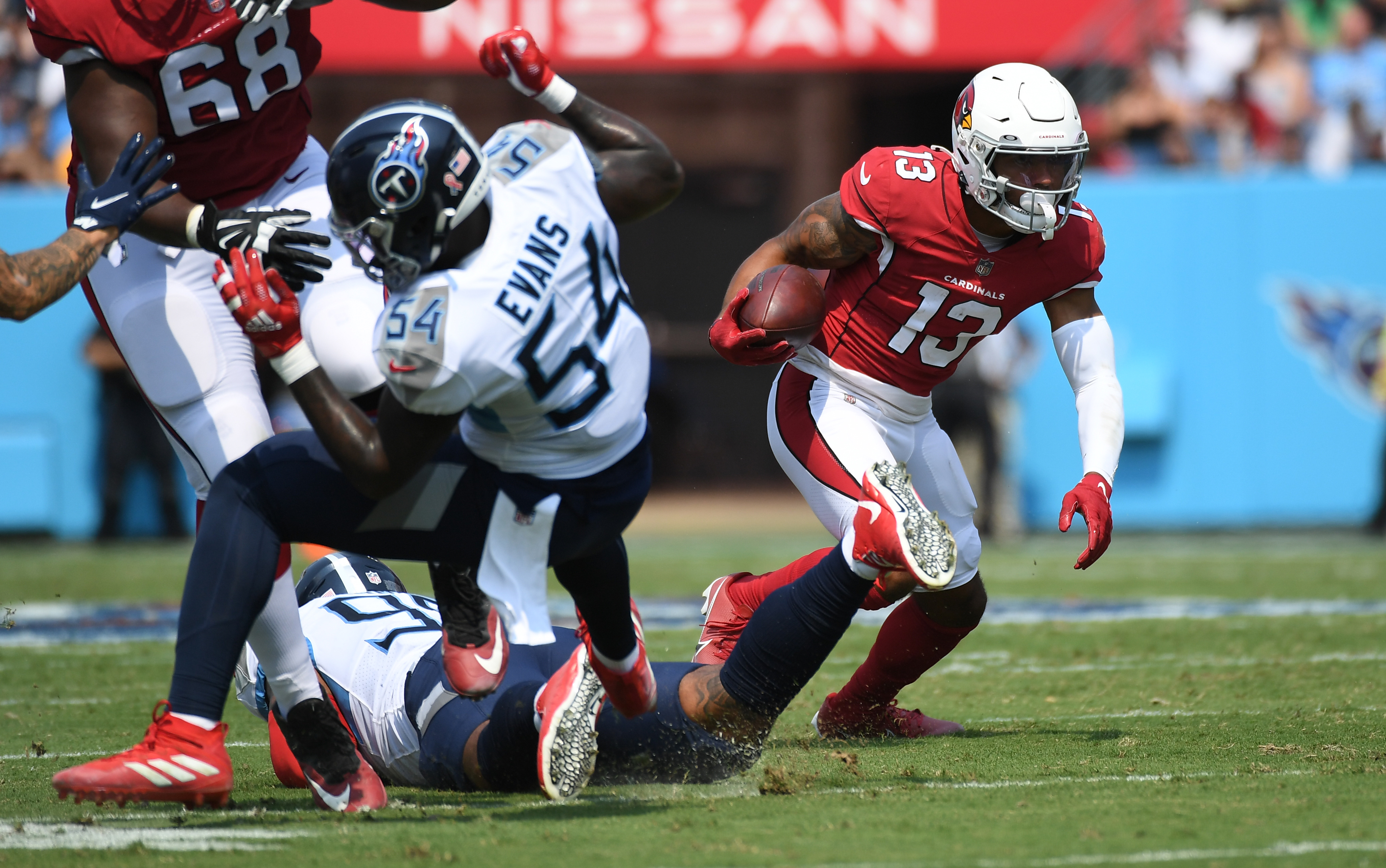 Arizona Cardinals wide receiver Christian Kirk (13) runs after a reception during the first half against the Tennessee Titans at Nissan Stadium.