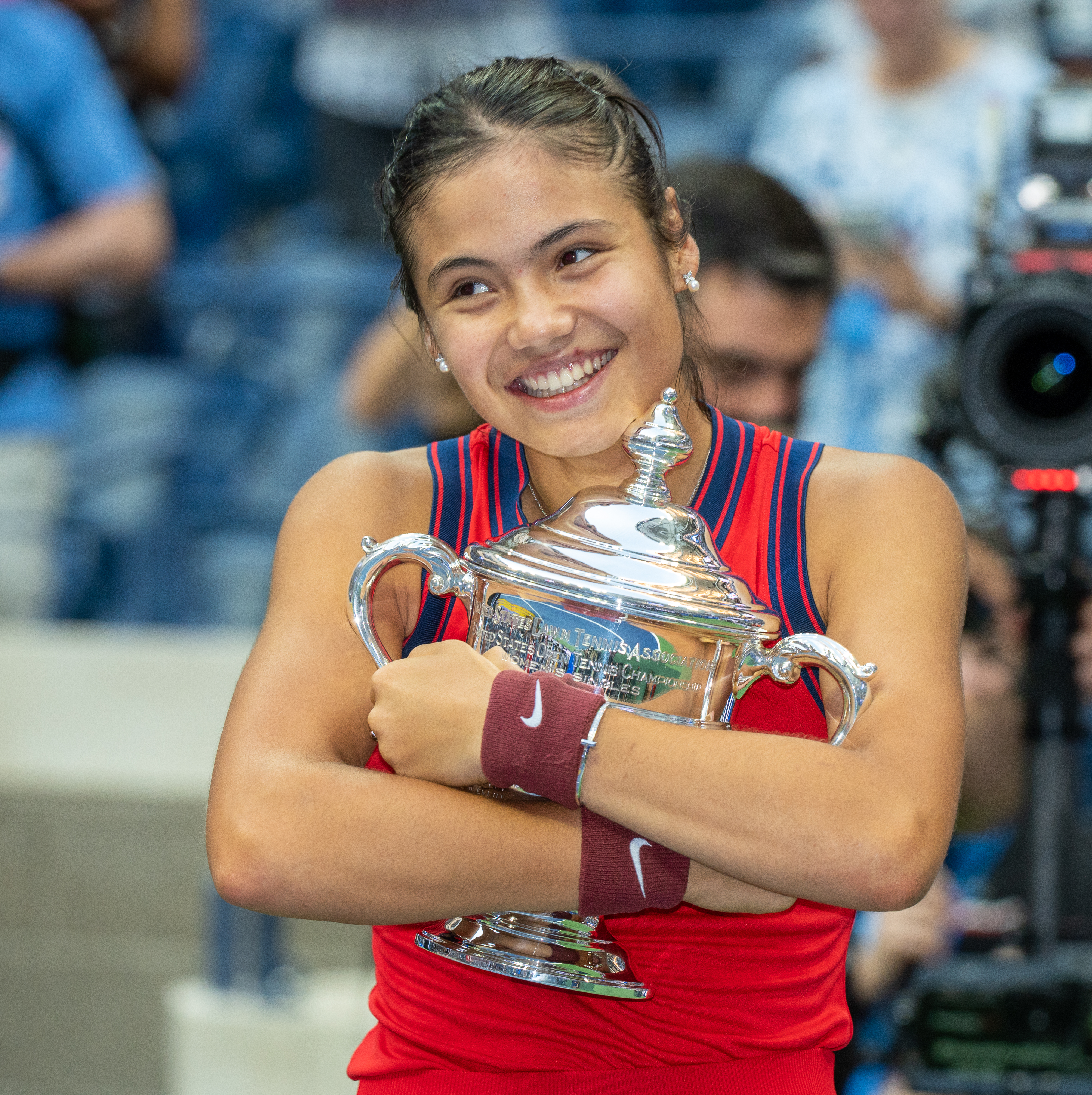Tennis champion Emma Raducanu hugging her trophy in disbelief after defeating Leylah Fernandez in the women's finals and receiving $2.5 million at the UST,A Billie Jean King Tennis Center in Flushing Meadow Park, in Queens, New York on September 10, 2021.