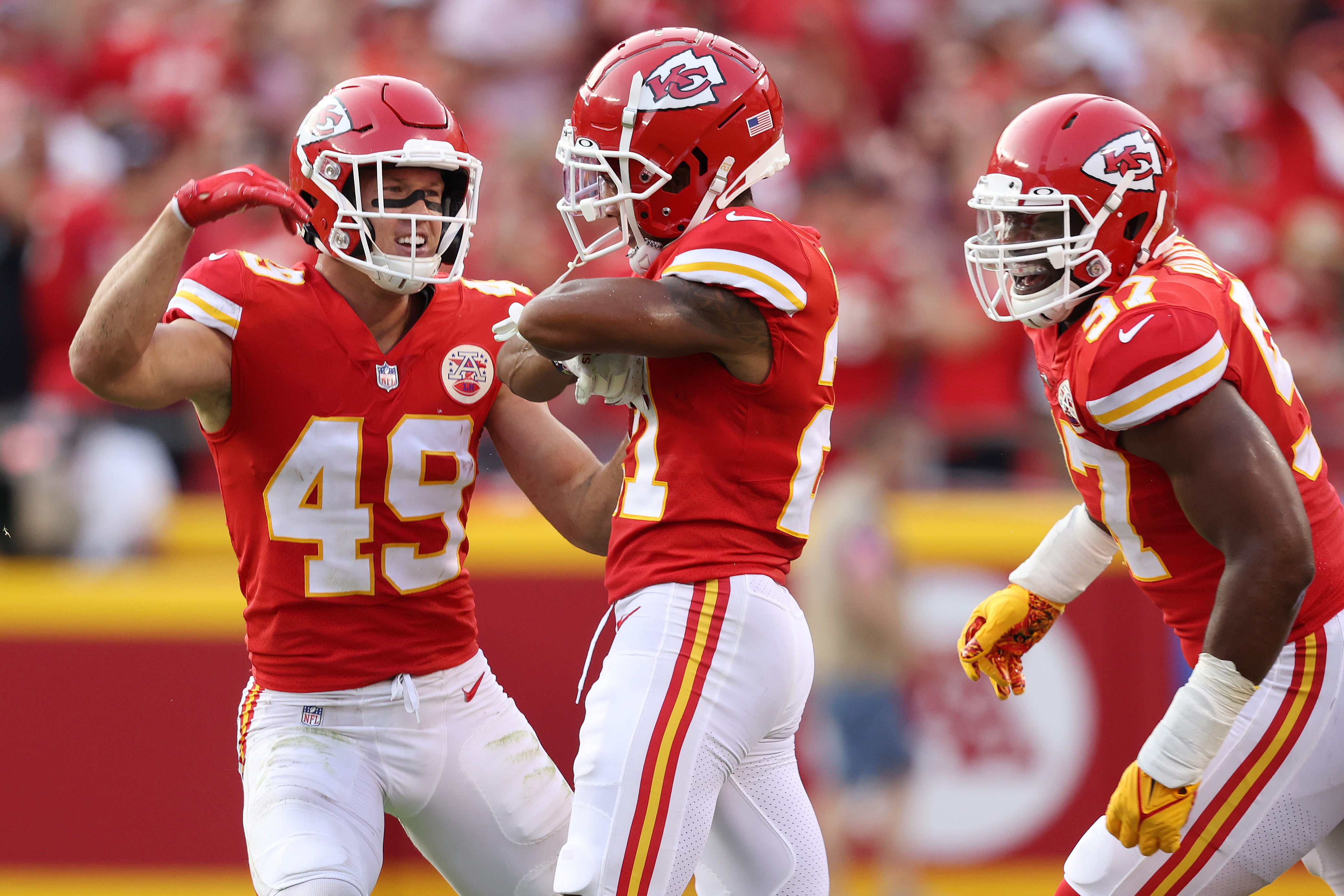 Mike Hughes #21 of the Kansas City Chiefs celebrates with Daniel Sorensen #49 and Malik Herring #97 against the Cleveland Browns during the second half at Arrowhead Stadium on September 12, 2021 in Kansas City, Missouri.