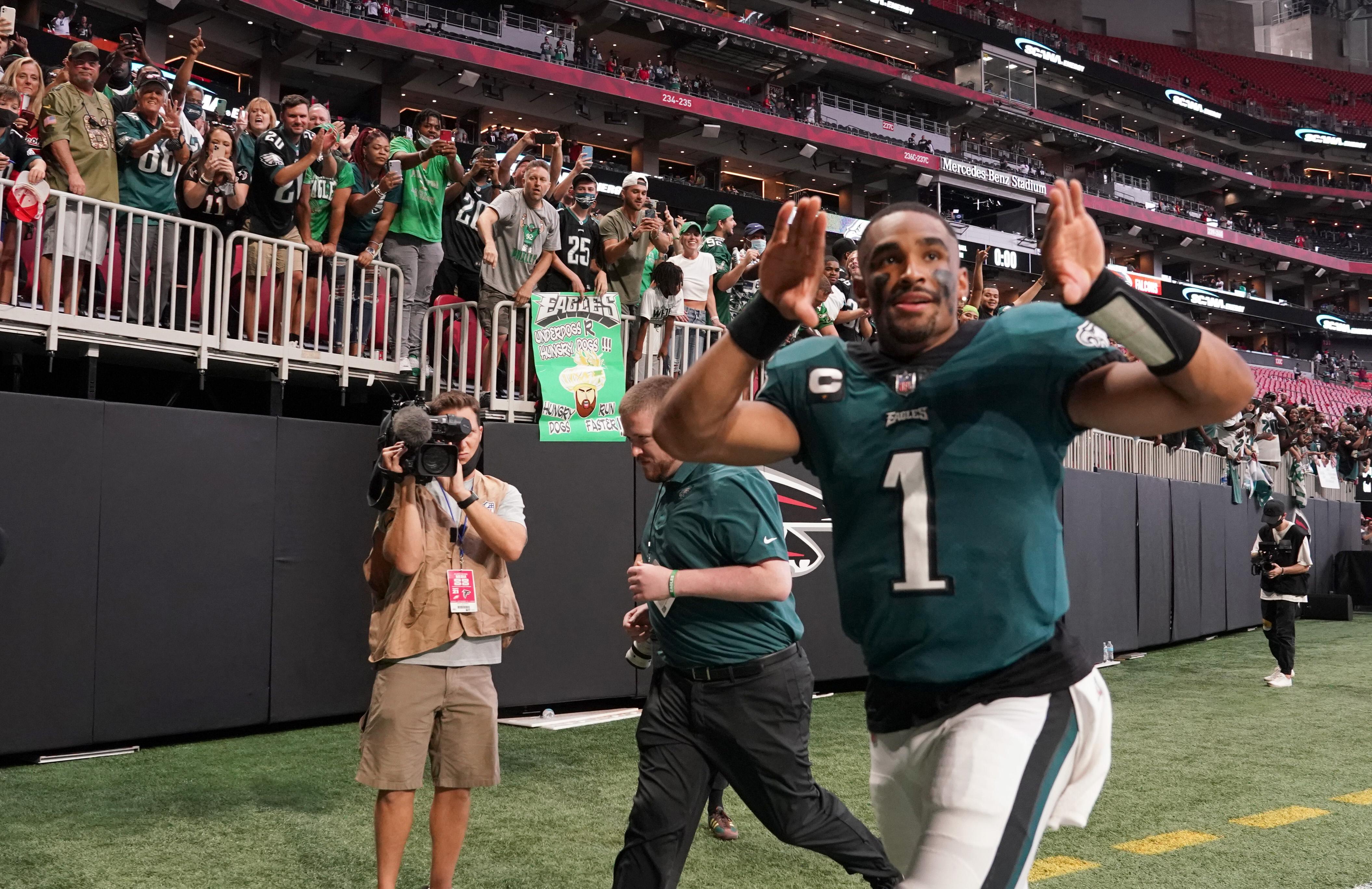 Philadelphia Eagles quarterback Jalen Hurts (1) celebrates as he runs off the field towards the Philadelphia Eagles fans after beating the Atlanta Falcons 32-6 at Mercedes-Benz Stadium.