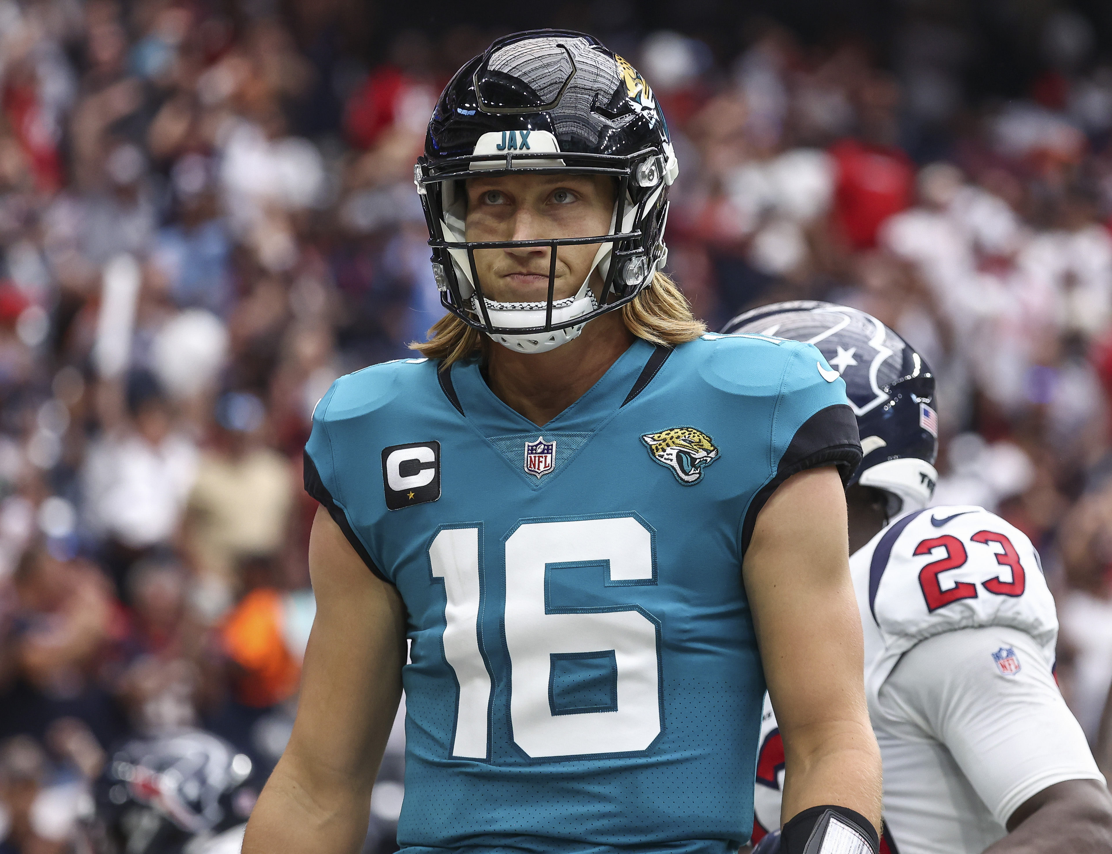 Jaguars quarterback Trevor Lawrence (16) reacts after throwing an interception during the second quarter against the Houston Texans at NRG Stadium.
