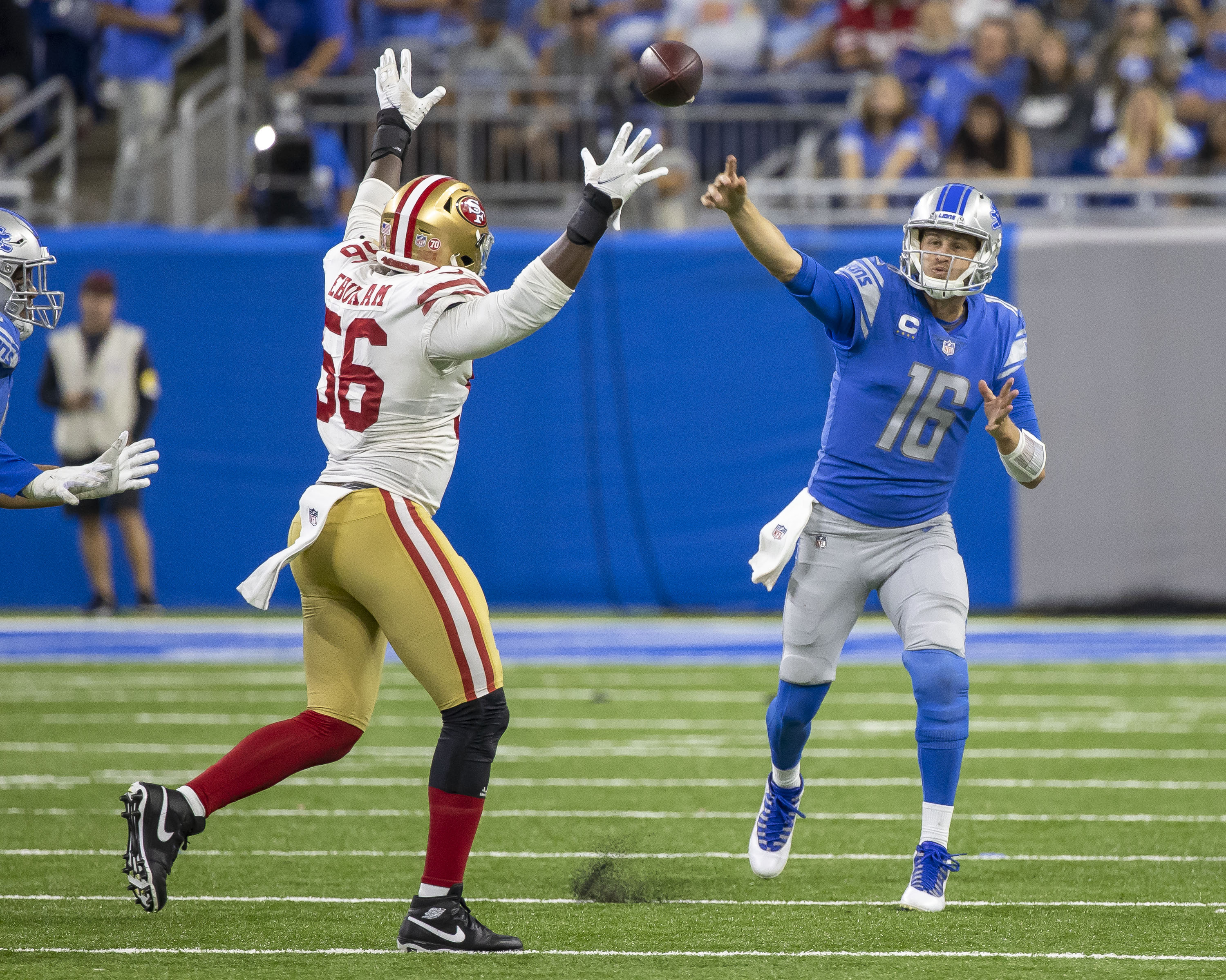 Detroit Lions quarterback Jared Goff (16) throws the ball over the arms of San Francisco 49ers outside linebacker Samson Ebukam (56) at Ford Field.