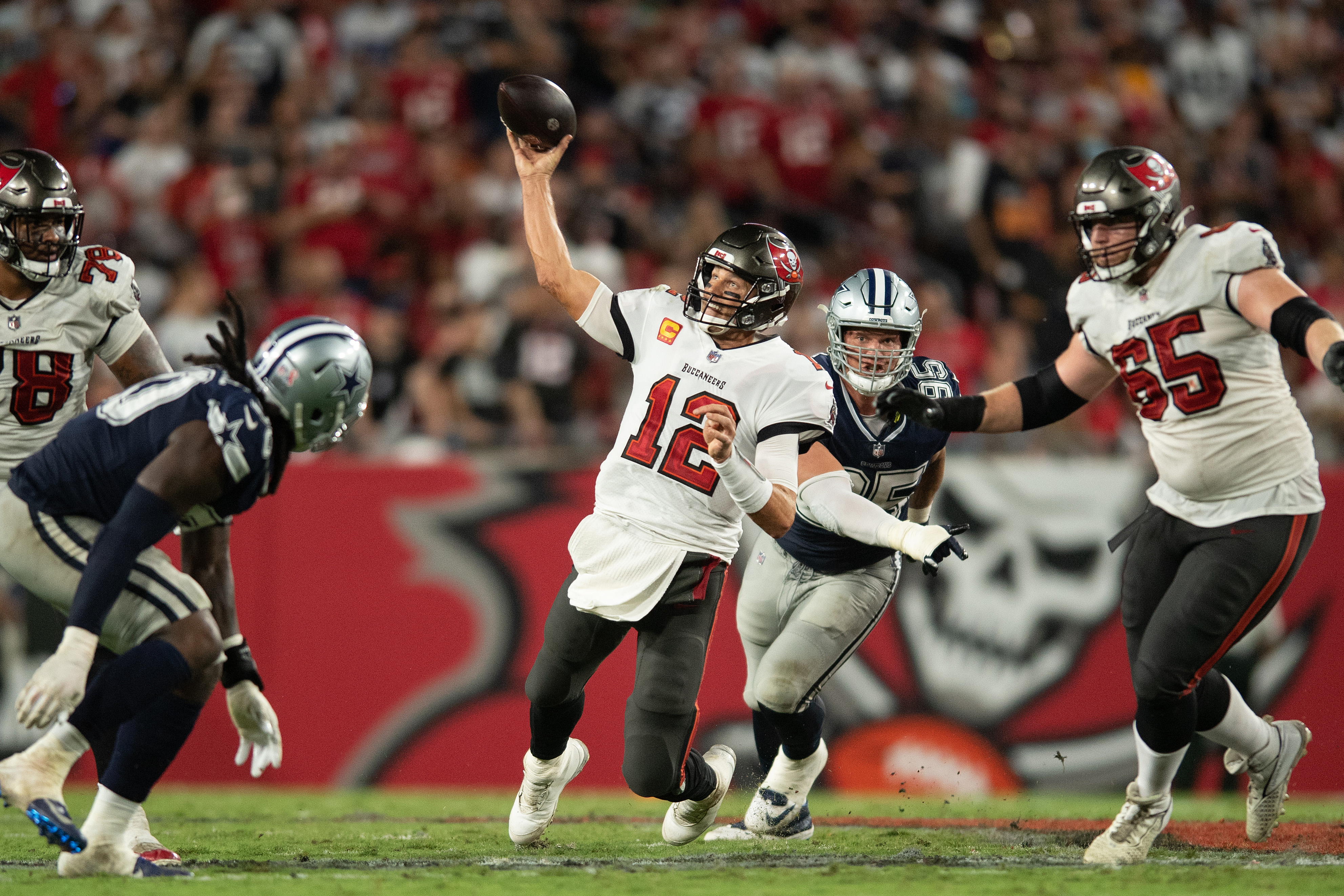 Tampa Bay Buccaneers quarterback Tom Brady (12) throws the ball against the Dallas Cowboys in the fourth quarter at Raymond James Stadium.