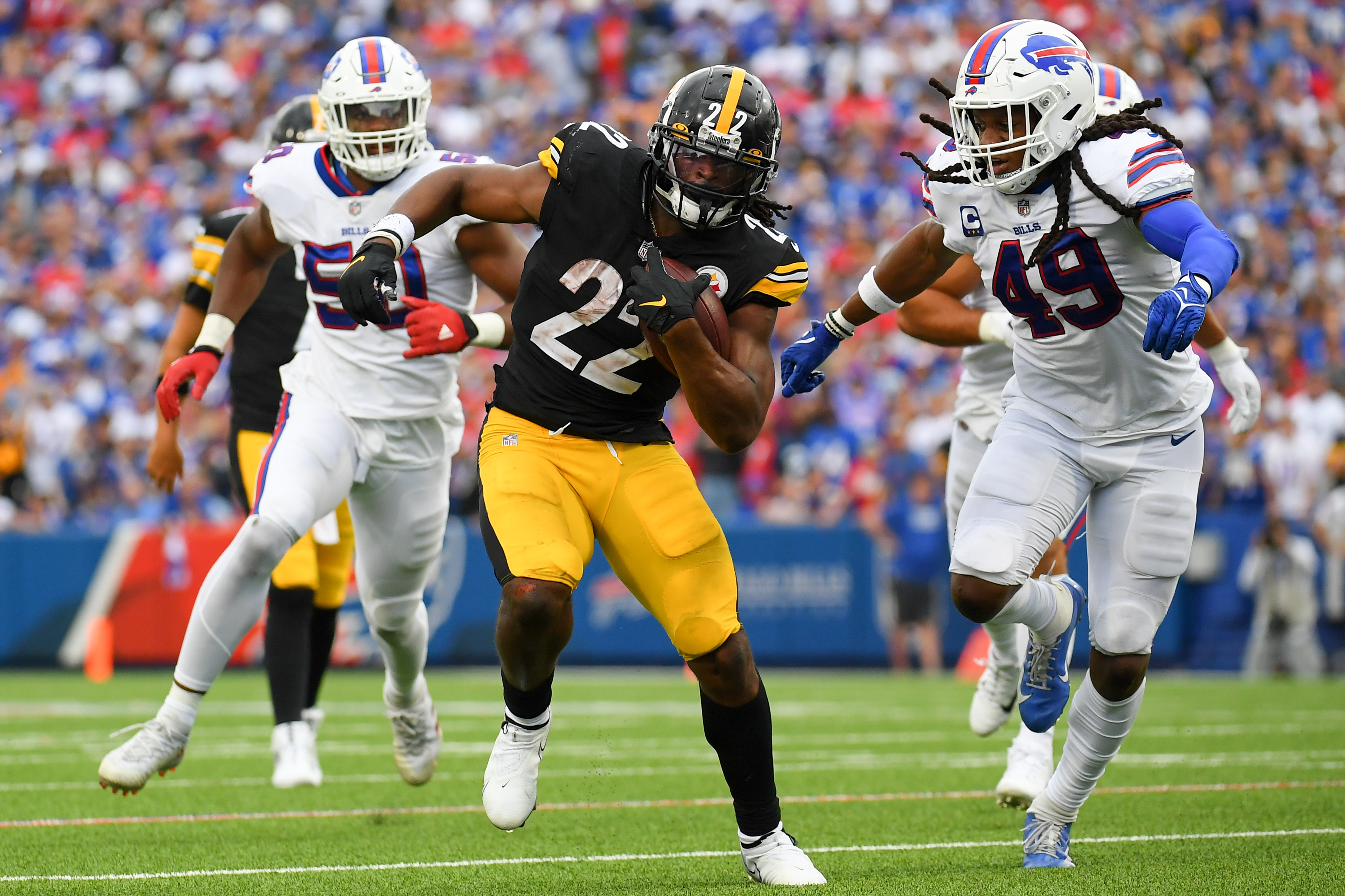 Pittsburgh Steelers running back Najee Harris (22) runs with the ball as Buffalo Bills middle linebacker Tremaine Edmunds (49) defends during the second half at Highmark Stadium.