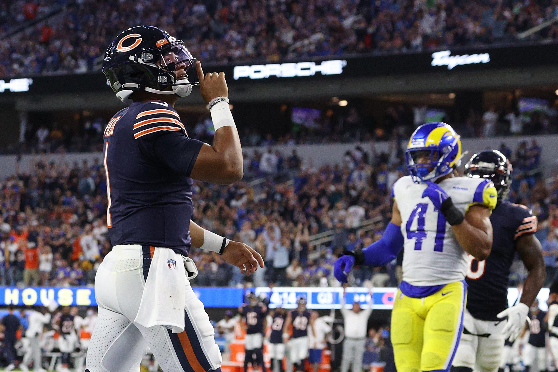 Bears backup quarterback Justin Fields celebrates a touchdown Sunday night.