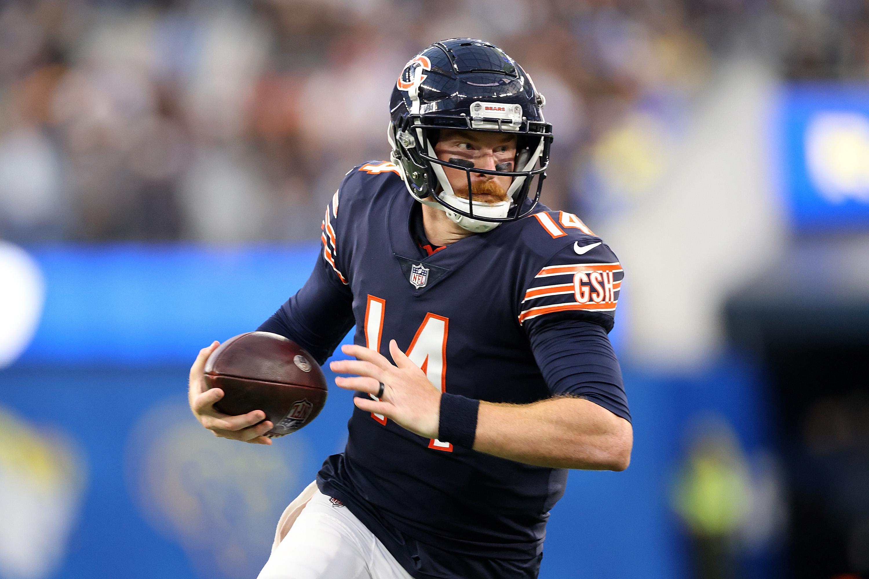 Bears quarterback Andy Dalton runs against the Rams on Sunday night.