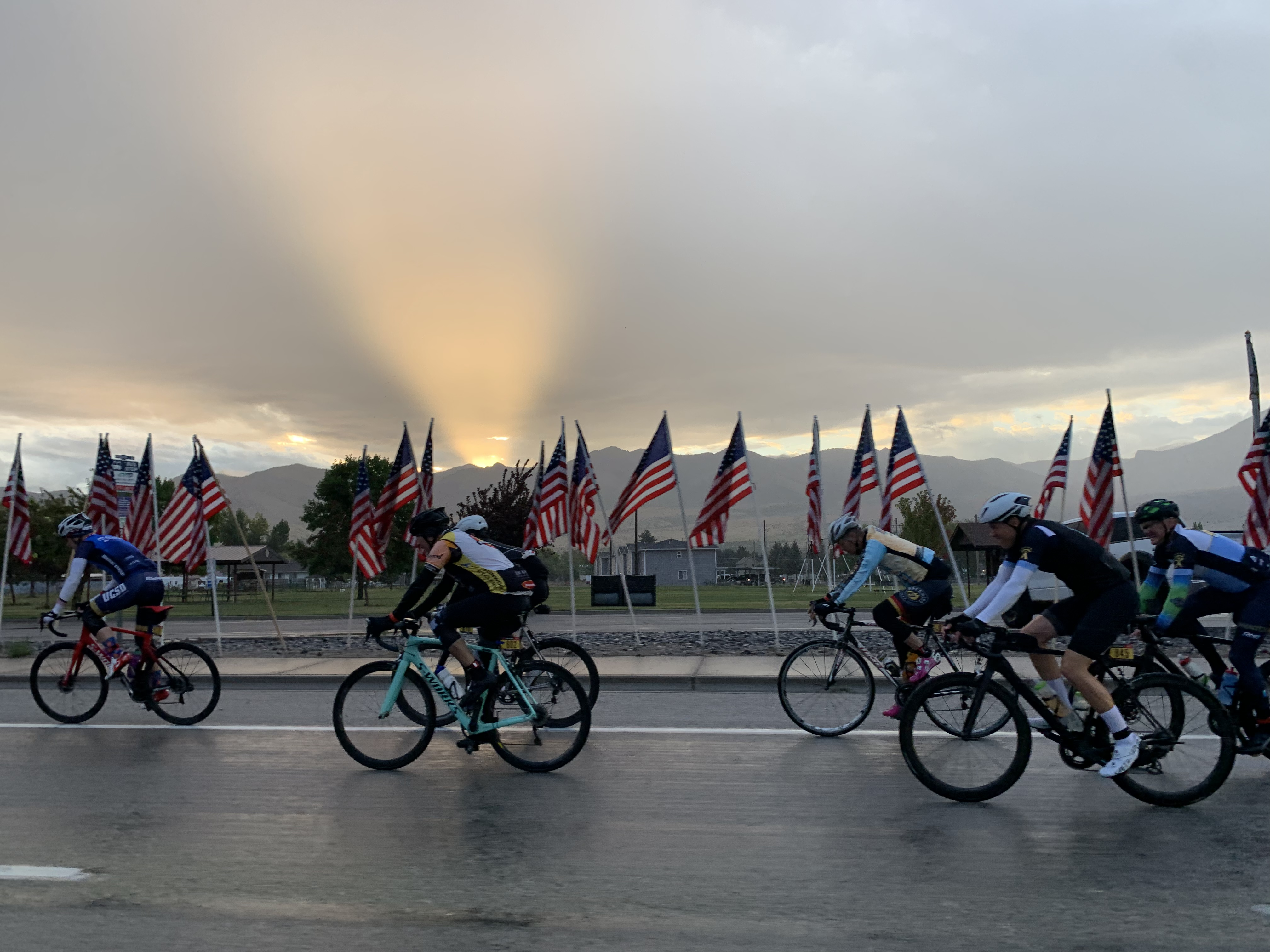 Cyclists complete in the 2021 LoToJa Classic on wet roads as the sun rises near Preston, Idaho, on Saturday, Sept. 11, 2021.