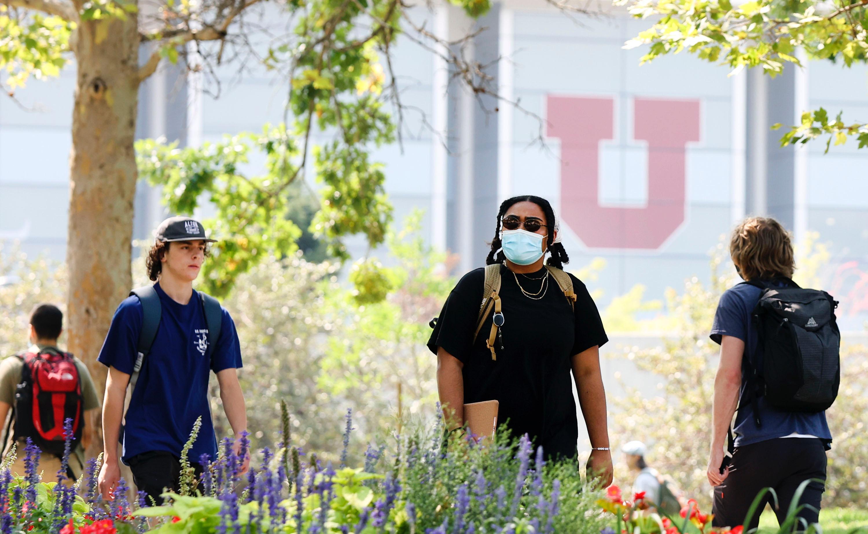 People walk on the University of Utah campus in Salt Lake City on Friday, Aug. 27, 2021.