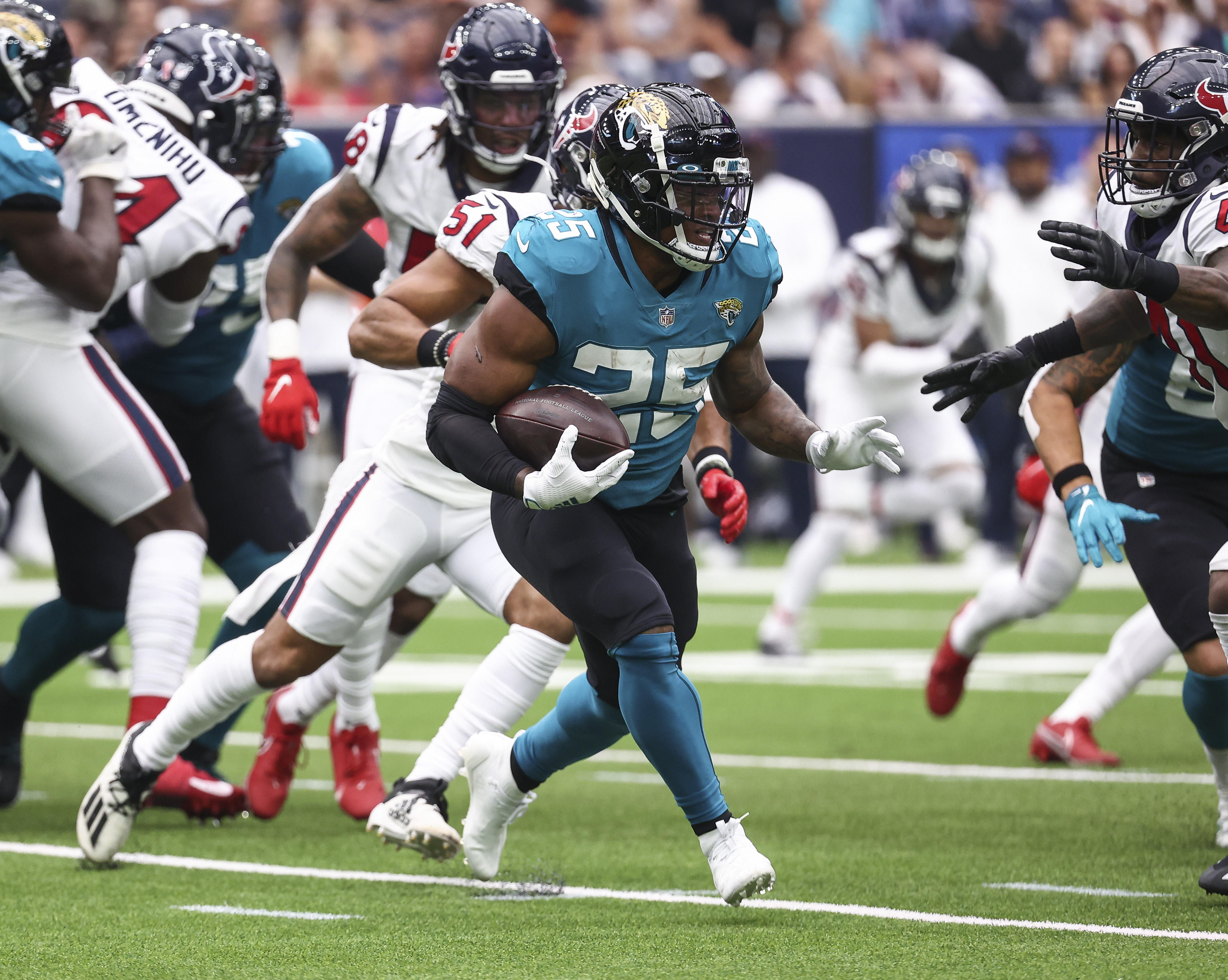 Jacksonville Jaguars running back James Robinson (25) runs with the ball during the second quarter against the Houston Texans at NRG Stadium.