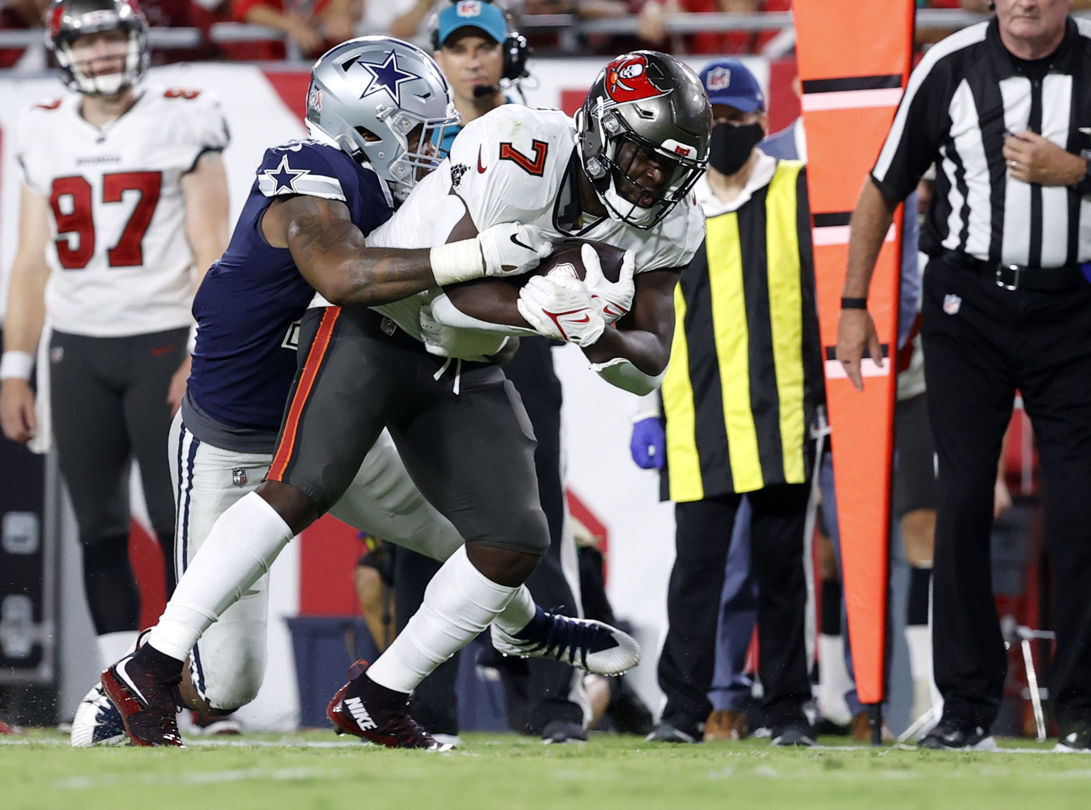 Tampa Bay Buccaneers running back Leonard Fournette (7) runs with the ball against Dallas Cowboys linebacker Micah Parsons (11) during the second half at Raymond James Stadium. Mandatory Credit: Kim Klement