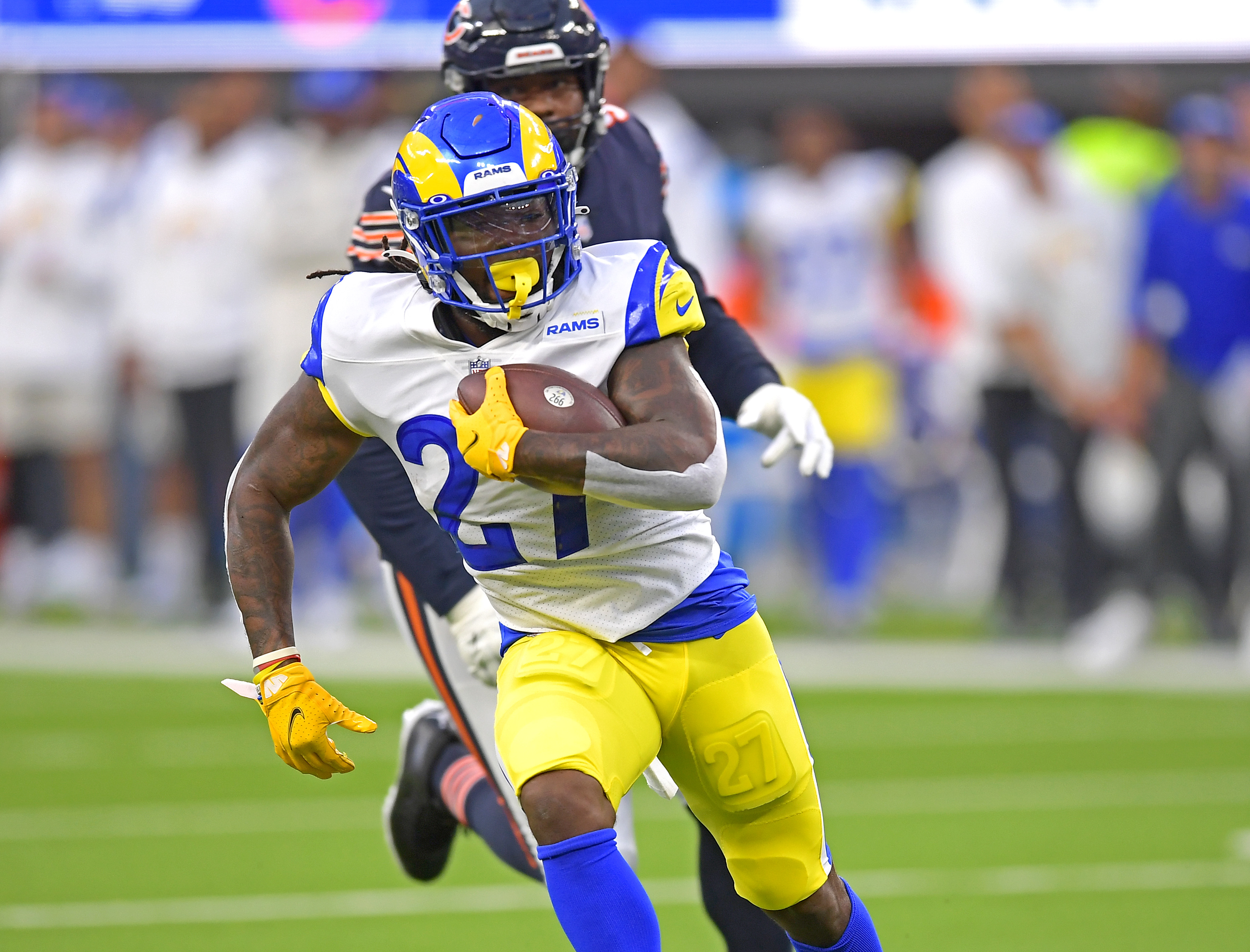 Los Angeles Rams running back Darrell Henderson breaks away from Chicago Bears outside linebacker Alec Ogletree and runs for a first down in the first half of the game at SoFi Stadium.