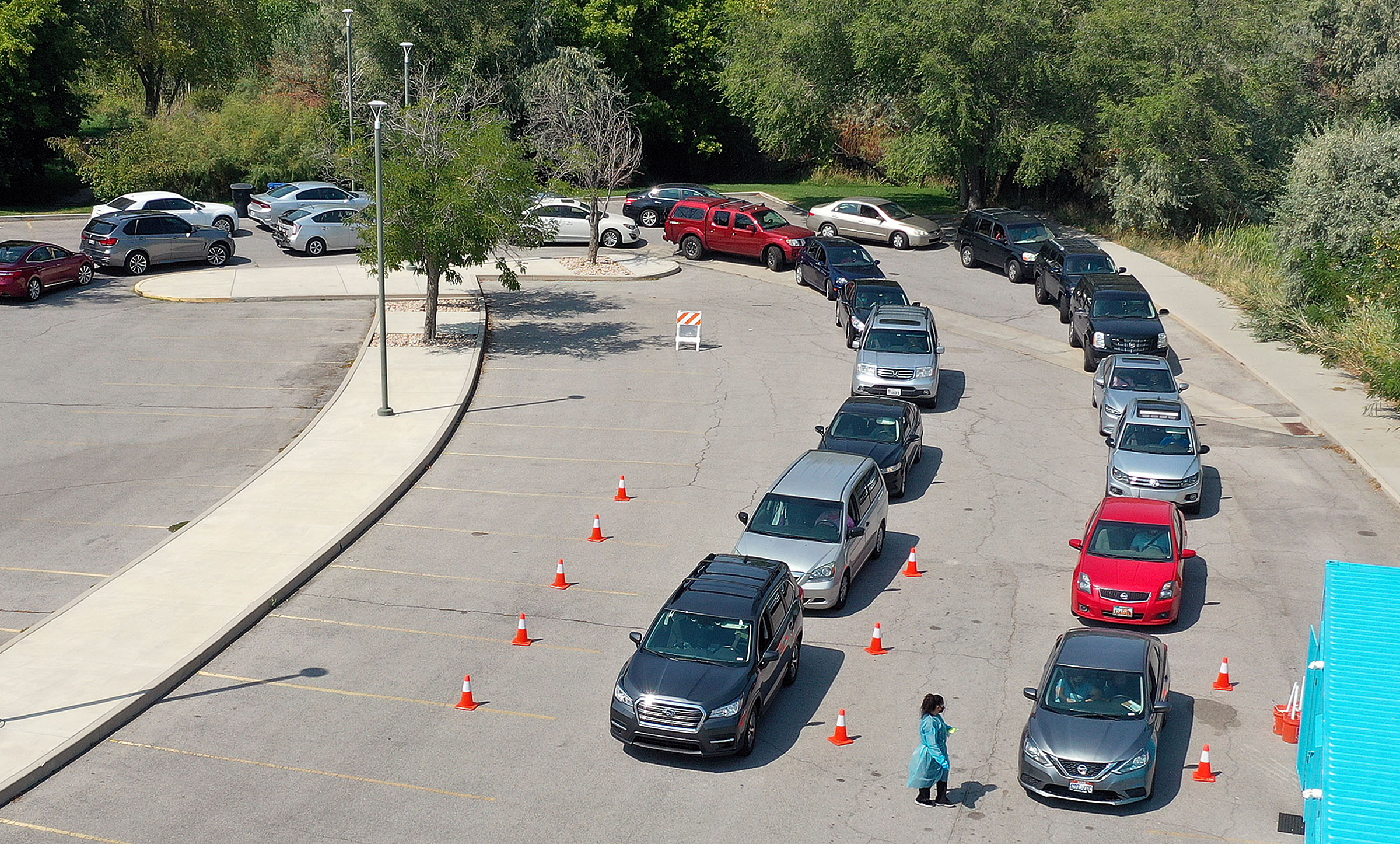 Vehicles line up outside of a COVID-19 testing site.