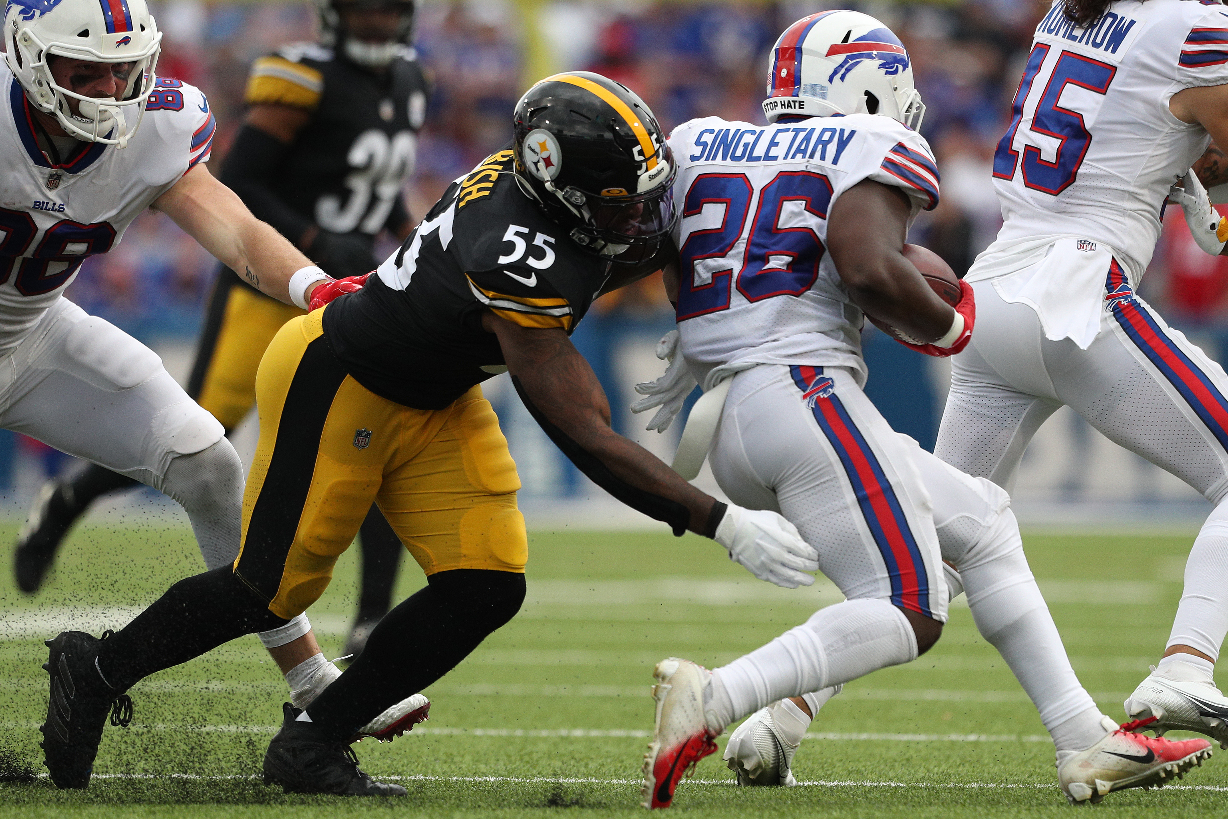 Devin Bush #55 of the Pittsburgh Steelers hits Devin Singletary #26 of the Buffalo Bills during the second half at Highmark Stadium on September 12, 2021 in Orchard Park, New York.