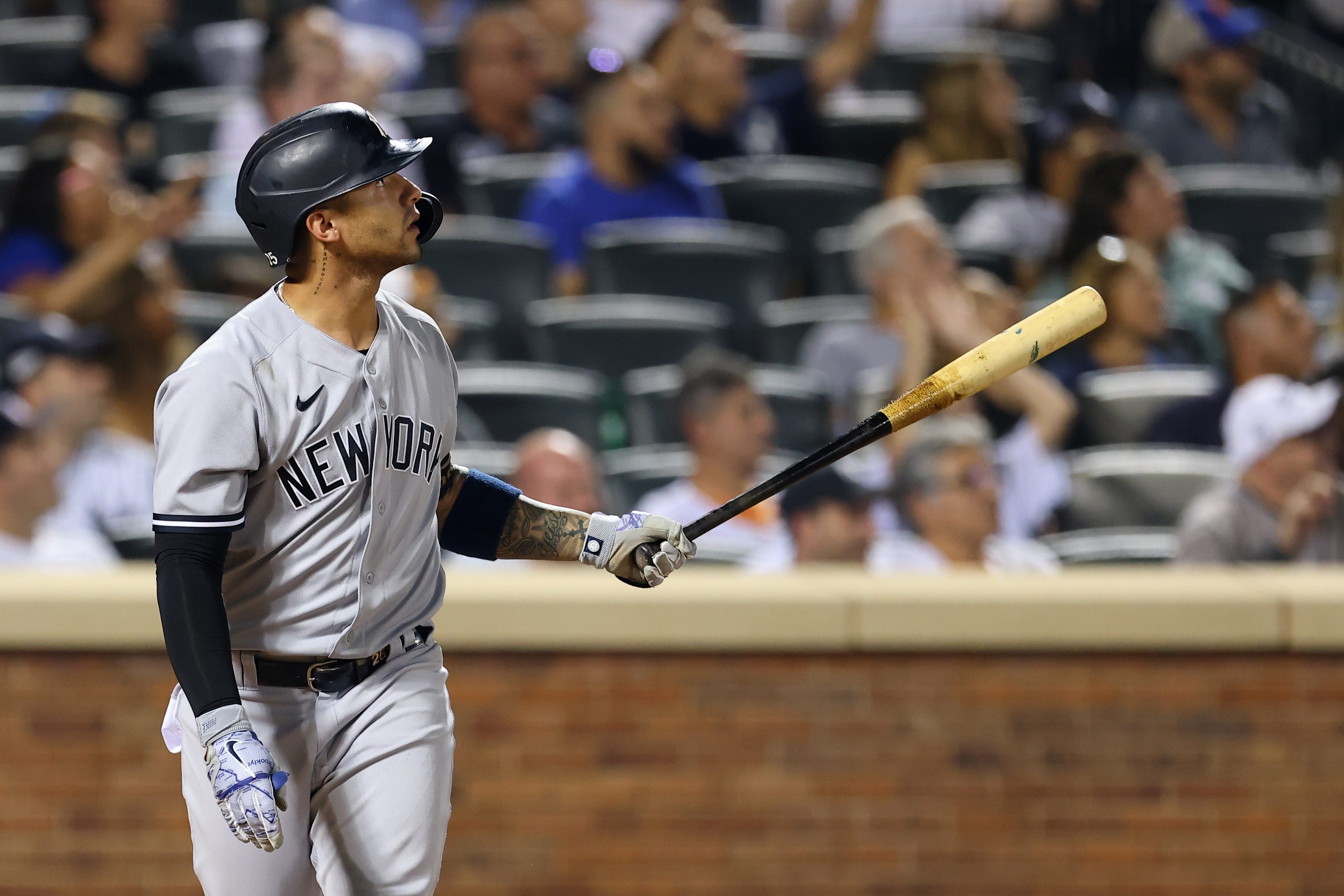 Gleyber Torres #25 of the New York Yankees watches the flight of his ball as he hits a two-run home run against the New York Mets during the sixth inning of a game at Citi Field on September 12, 2021 in New York City.