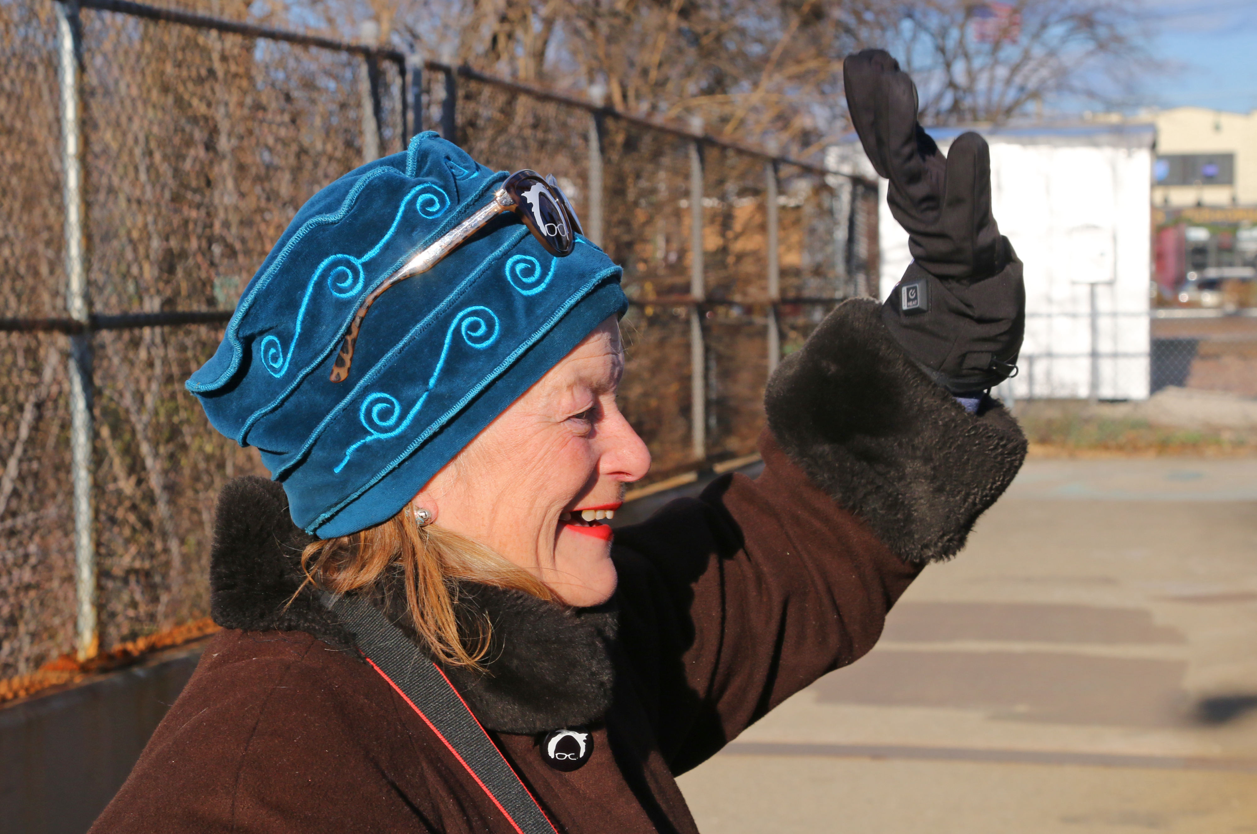 Veronica Wolski waves to drivers as she protests with banners on a Kennedy expressway pedestrian bridge in 2017.