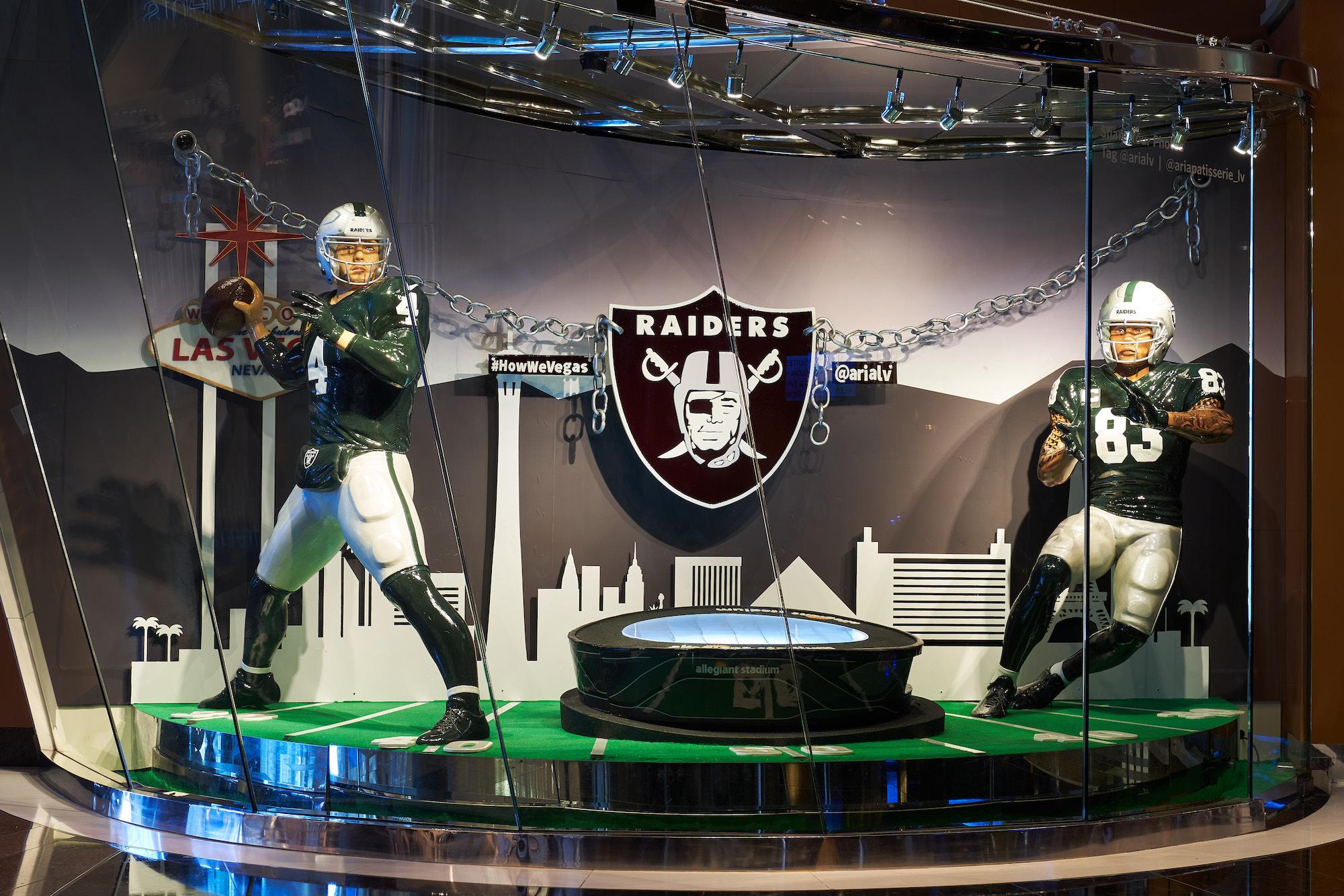 A replica of a Las Vegas Raiders quarterback and tight end