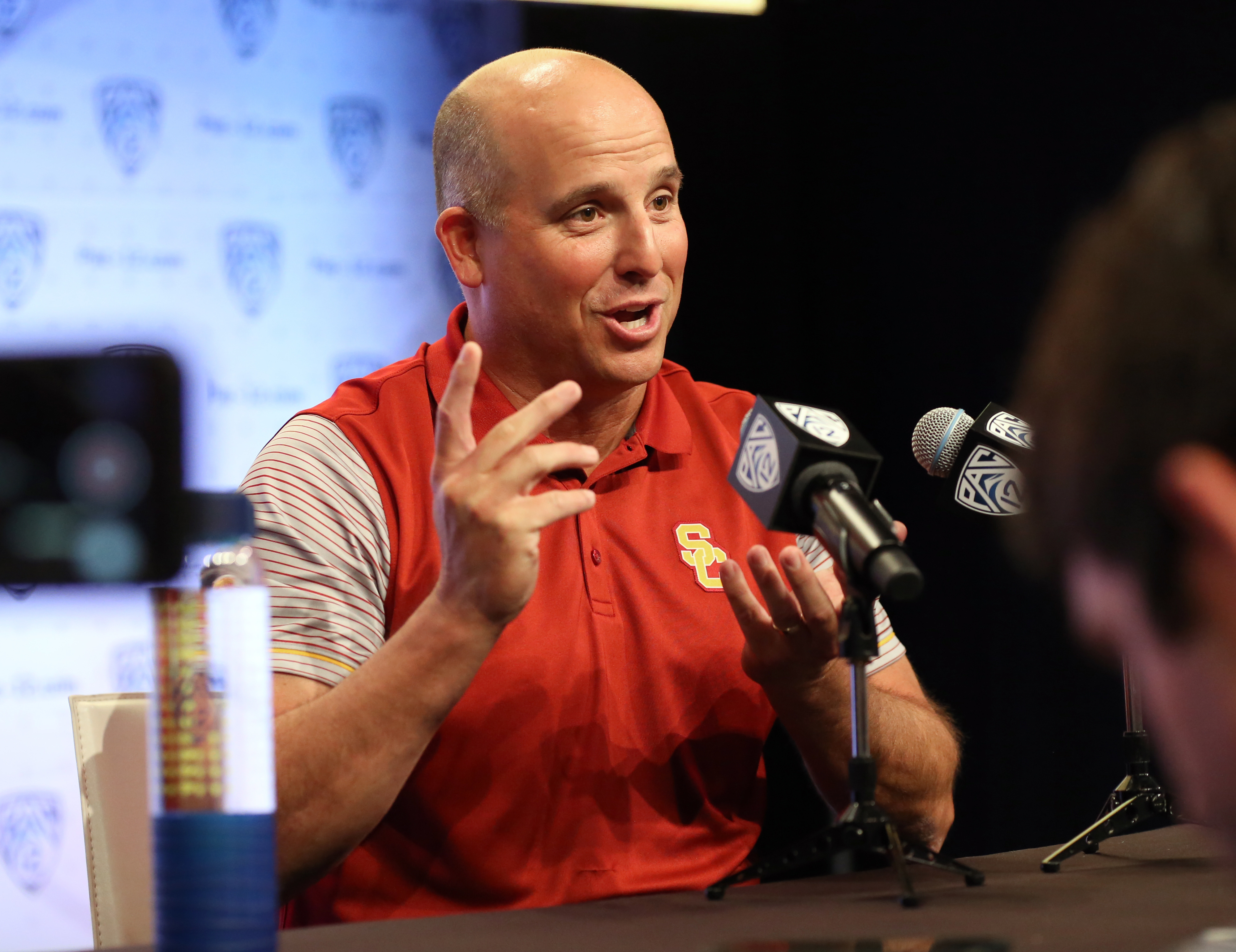 USC head coach Clay Helton talks about 'juggling' several roles during his time at USC as he speaks to reporters at the Pac-12 NCAA college football media day in Los Angeles Thursday, July 14, 2016. Helton was fired by the Trojans on Monday.