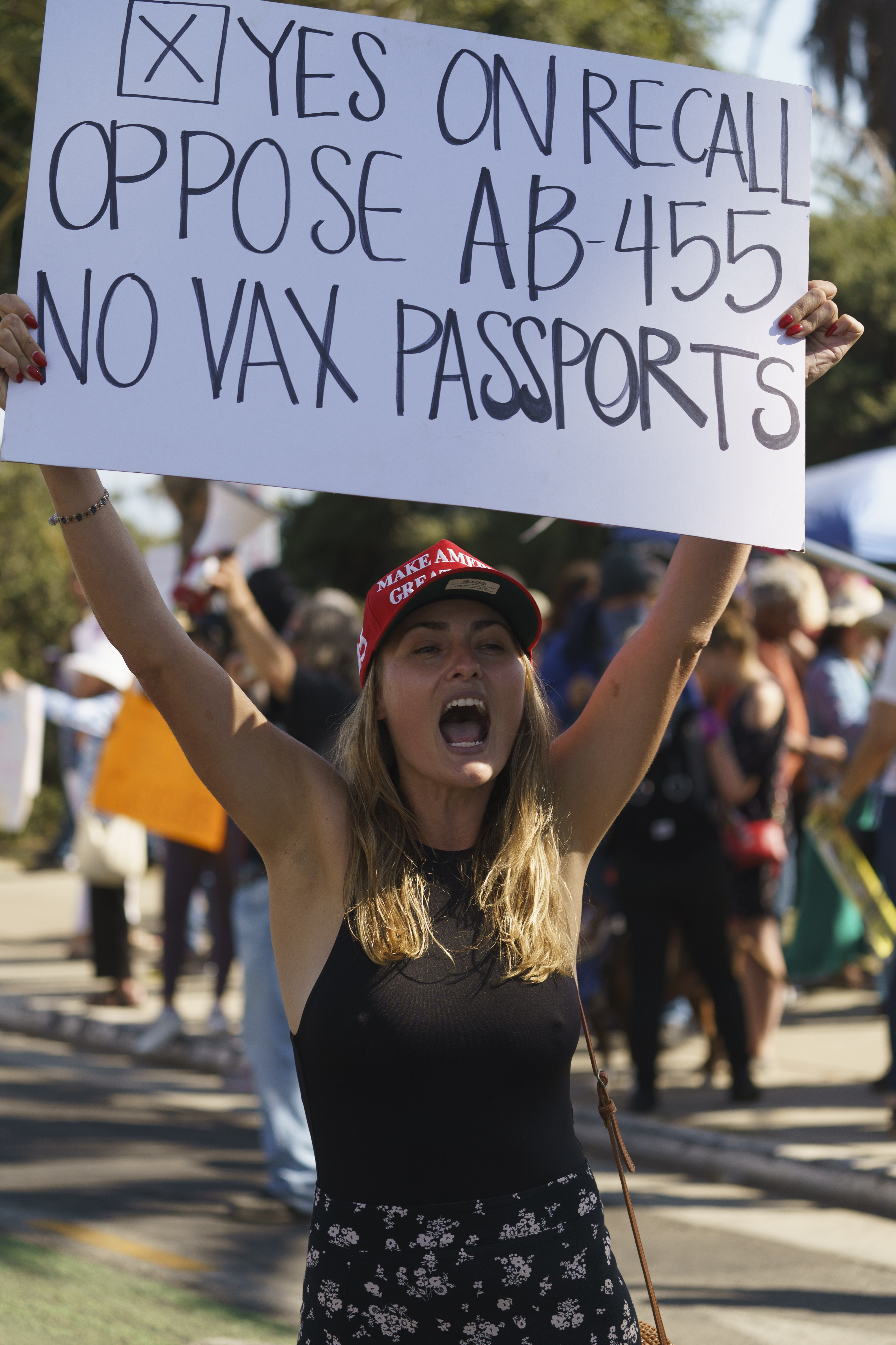 Demonstrators rally against a vaccine mandate for passports.