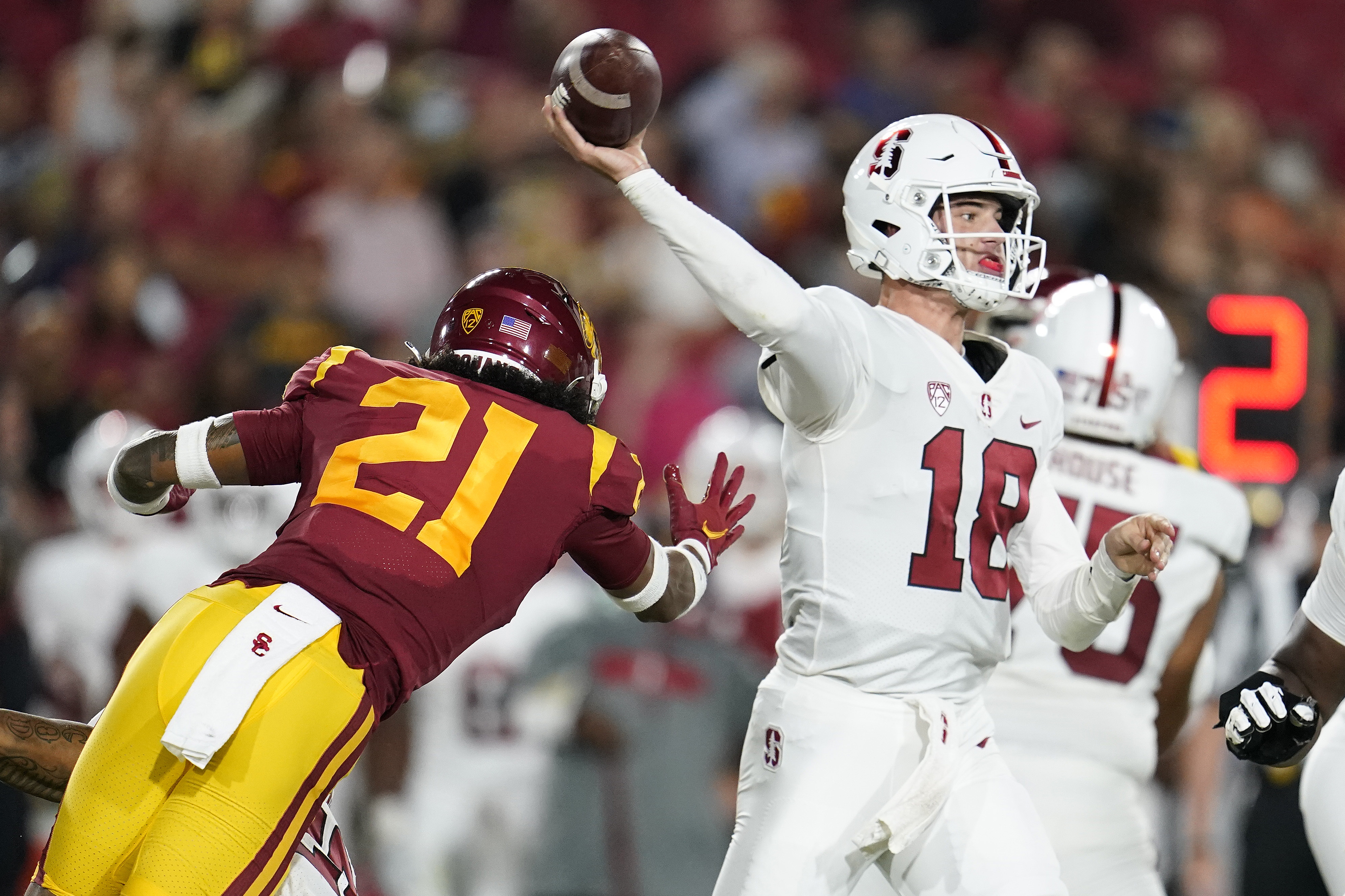 Stanford quarterback Tanner McKee throws past USC safety Isaiah Pola-Mao during game Saturday, Sept. 11, 2021, in Los Angeles.