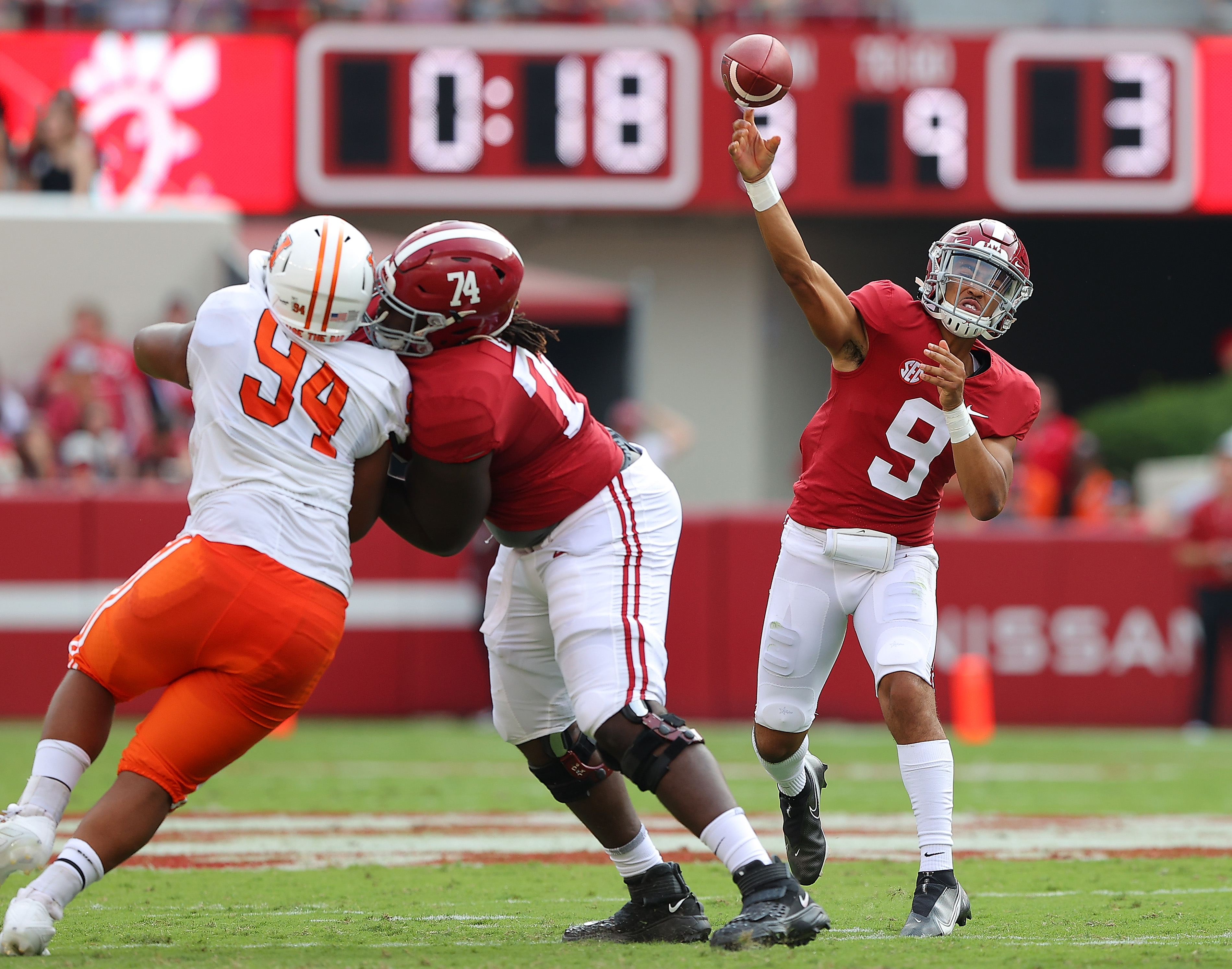 Bryce Young of the Alabama Crimson Tide passes against the Mercer Bears during the first half at Bryant-Denny Stadium on September 11, 2021 in Tuscaloosa, Alabama.