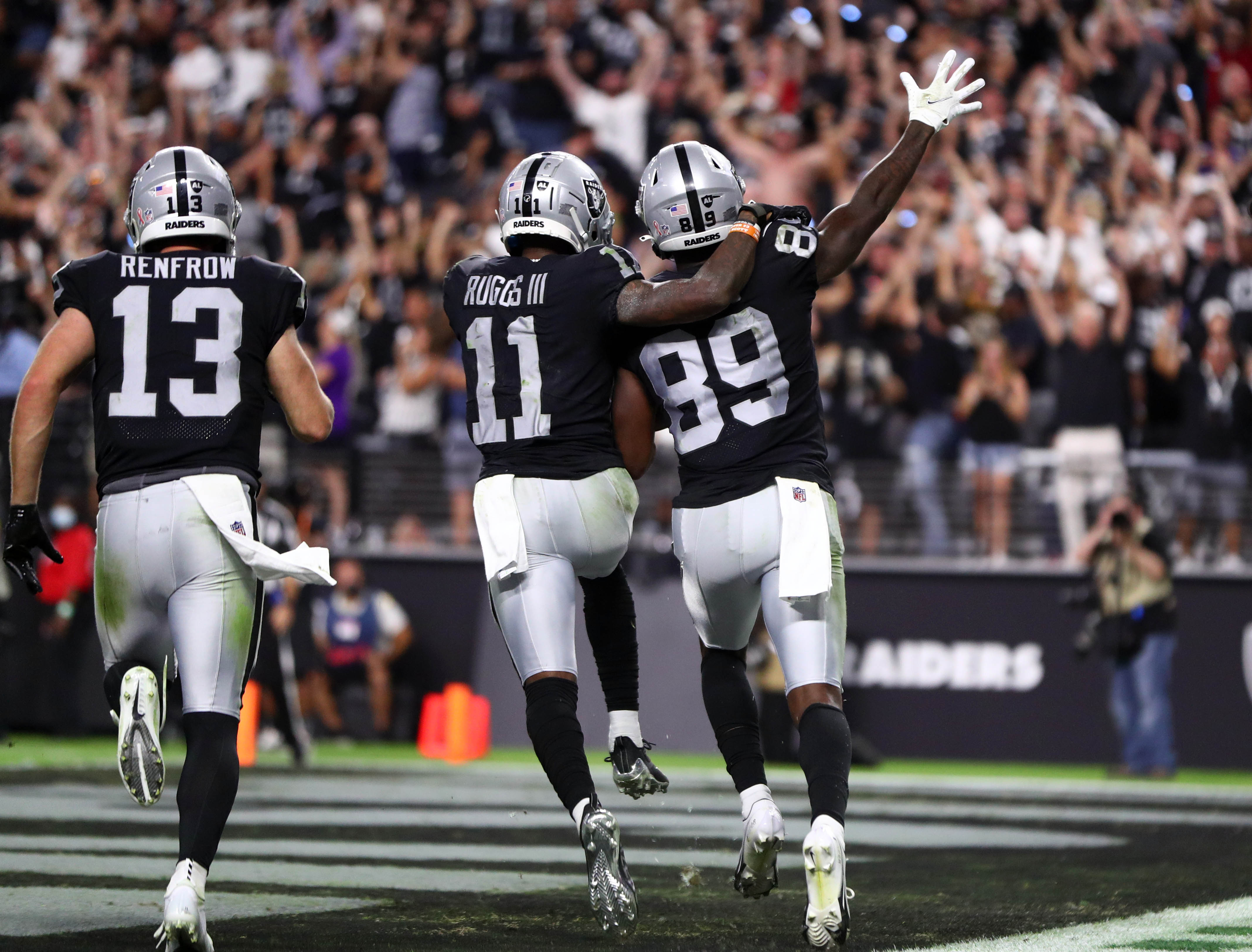 Las Vegas Raiders wide receiver Bryan Edwards (89) celebrates after running the ball into the endzone against the Baltimore Ravens during overtime at Allegiant Stadium.
