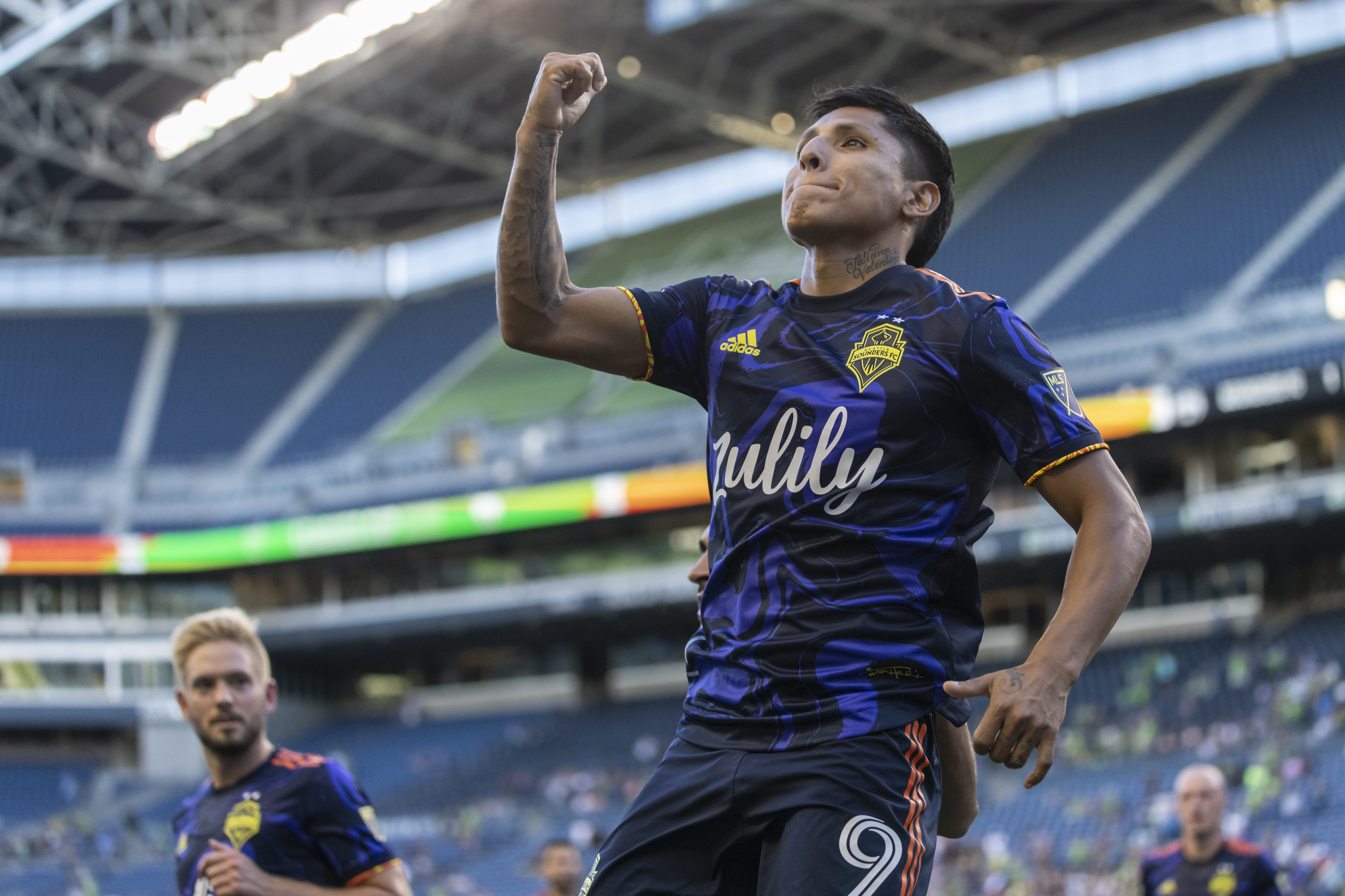 Raul Ruidiaz #9 of Seattle Sounders FC celebrates after scoring a goal on a penalty kick during the first half of a match against Tigres UANL at Lumen Field on August 10, 2021 in Seattle, Washington.