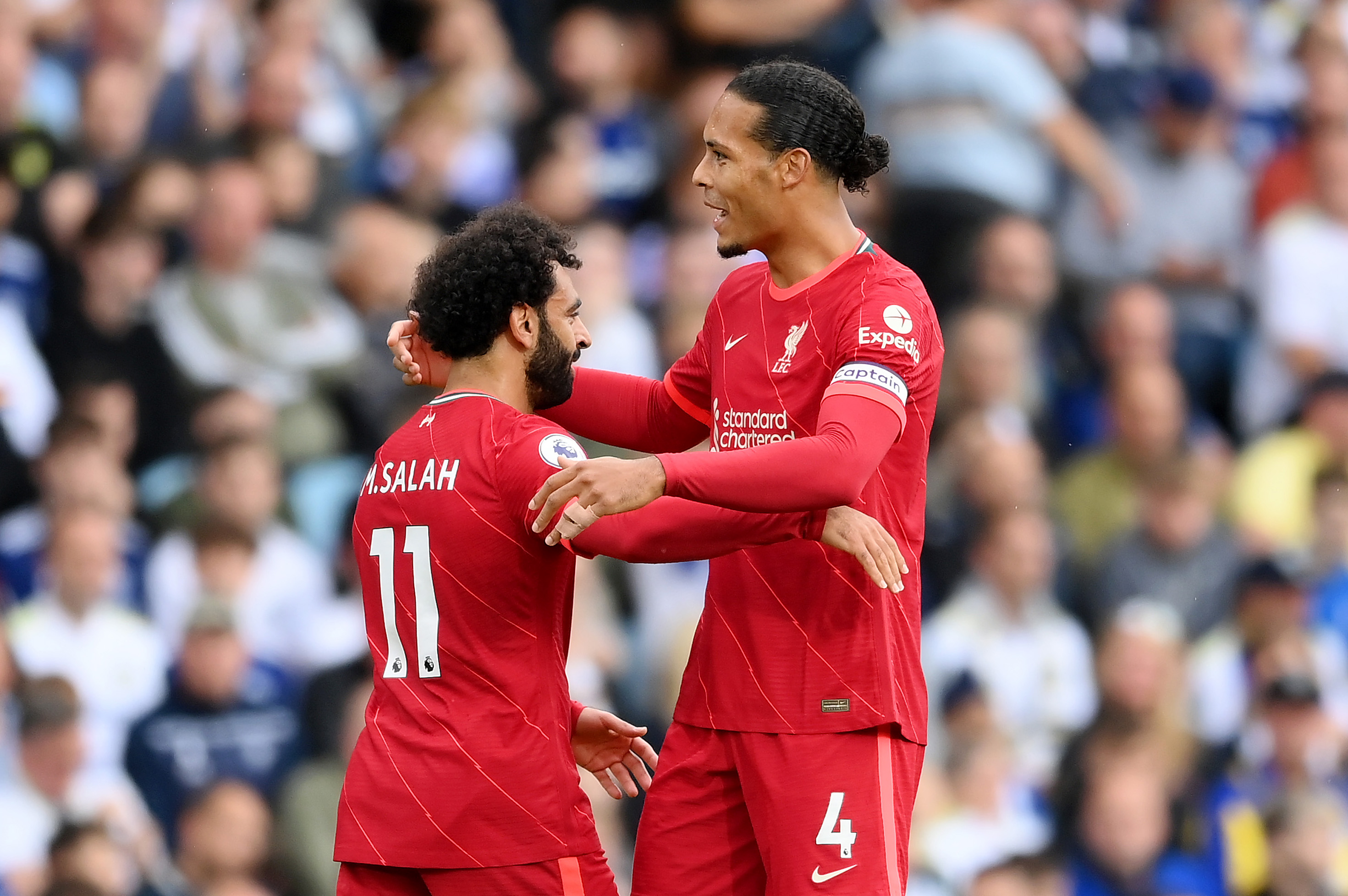 Mohamed Salah celebrates with Virgil van Dijk - Liverpool - Champions League