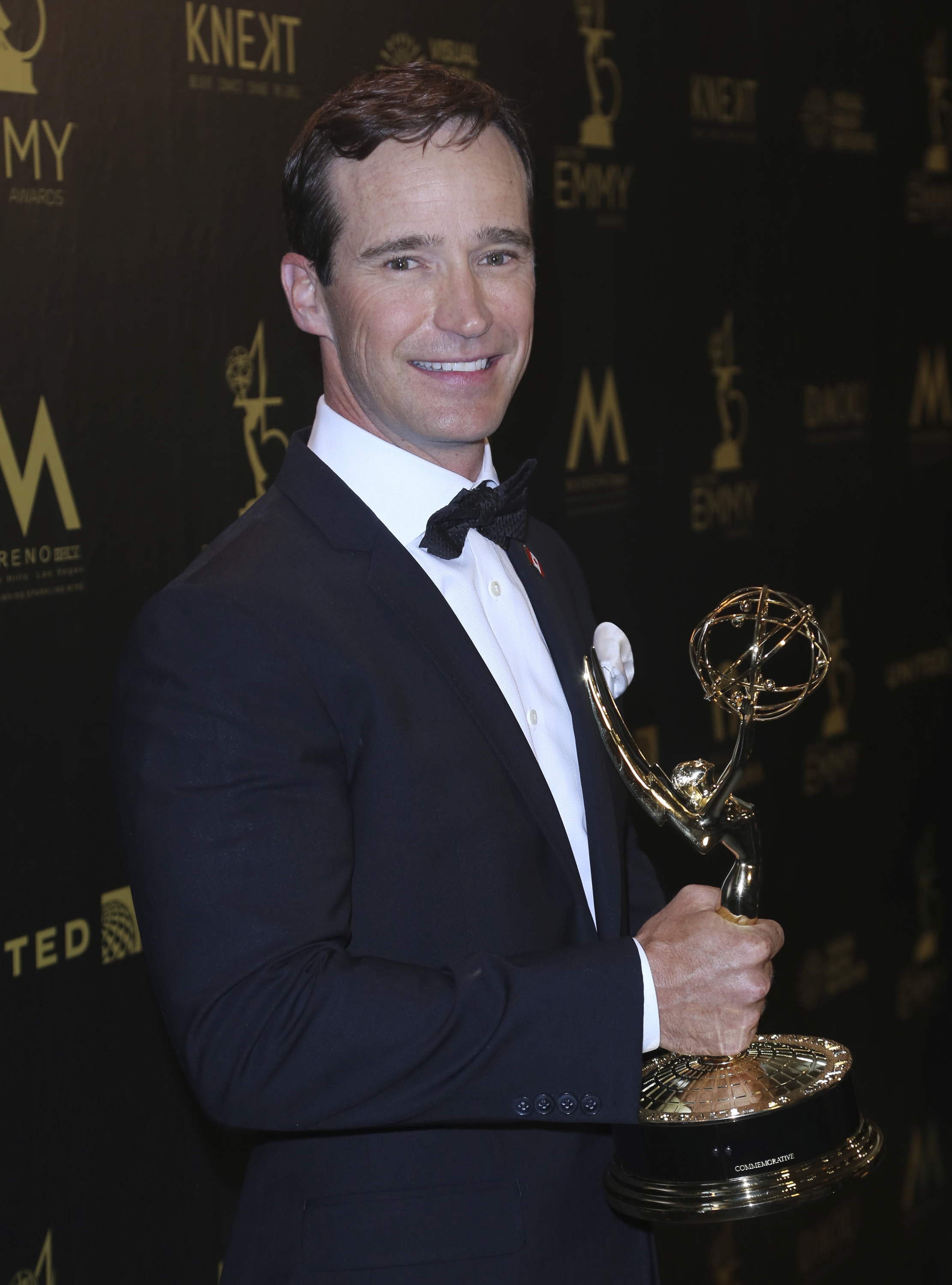 """Mike Richards poses in the press room with the award for outstanding game show for """"The Price is Right"""" at the 45th annual Daytime Emmy Awards at the Pasadena Civic Center in Pasadena, California."""