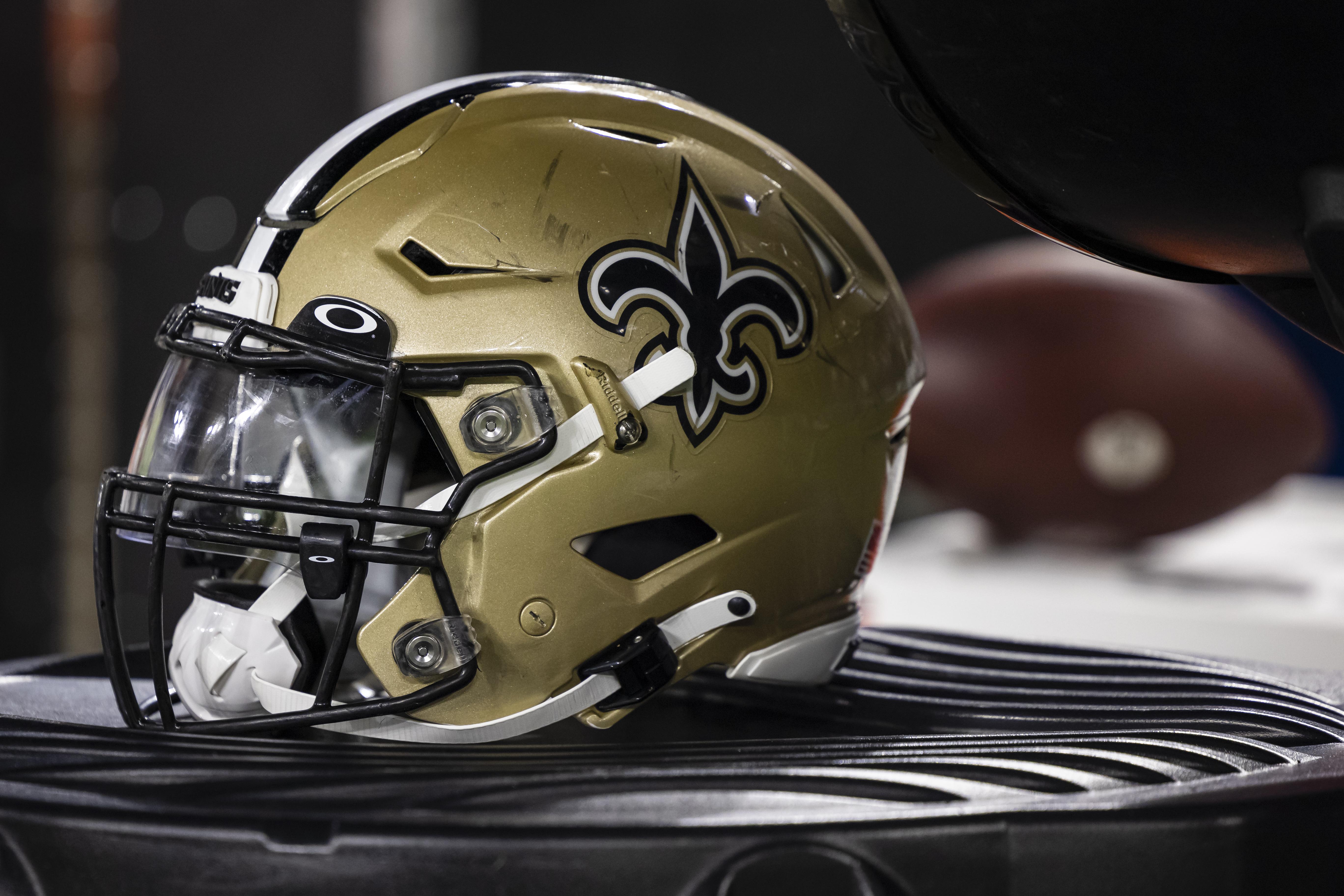 A New Orleans Saints helmet is seen on the sidelines during the second half of a preseason game against the Baltimore Ravens at M&T Bank Stadium on August 14, 2021 in Baltimore, Maryland.