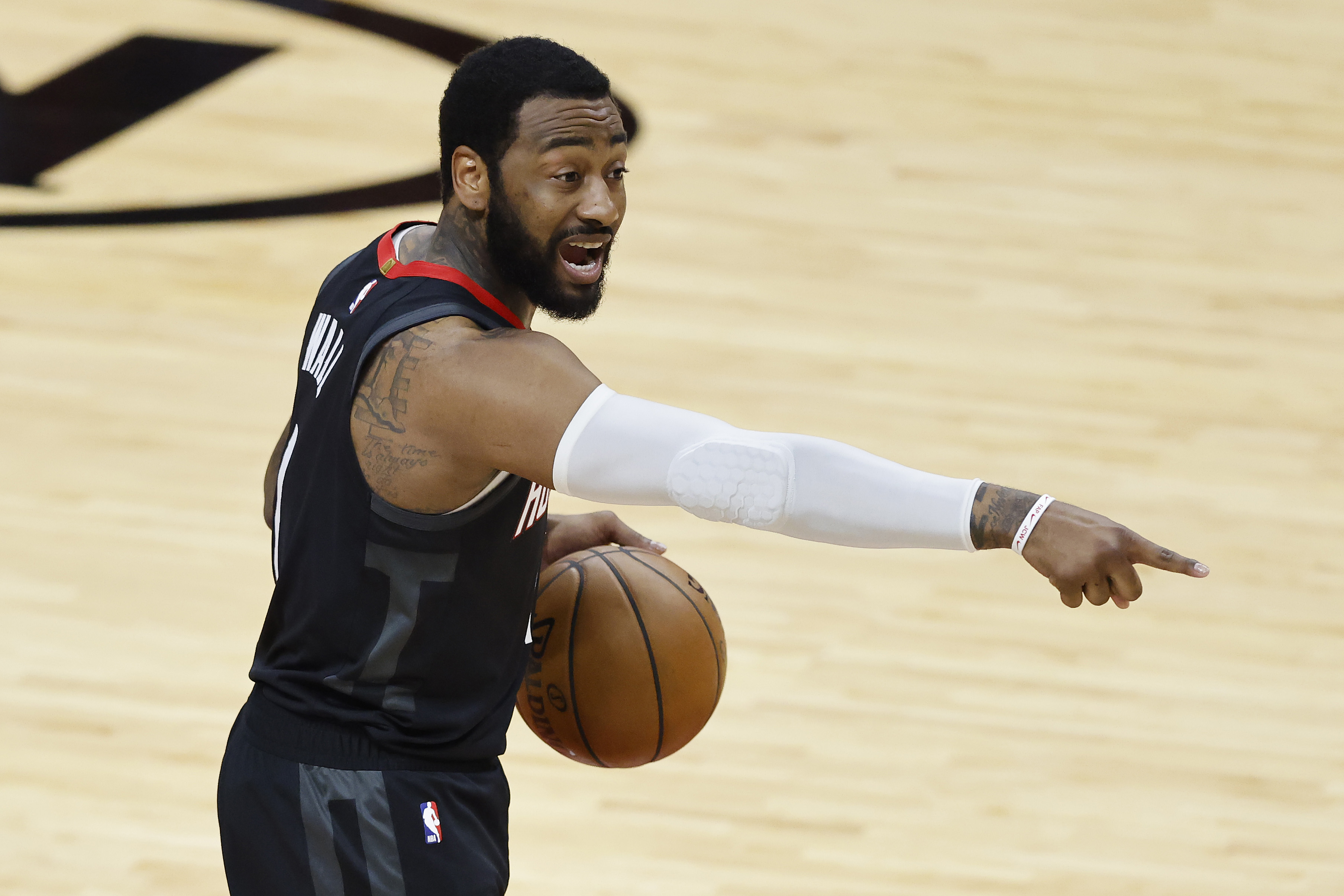 John Wall of the Houston Rockets reacts against the Miami Heat during the second quarter at American Airlines Arena on April 19, 2021 in Miami, Florida.