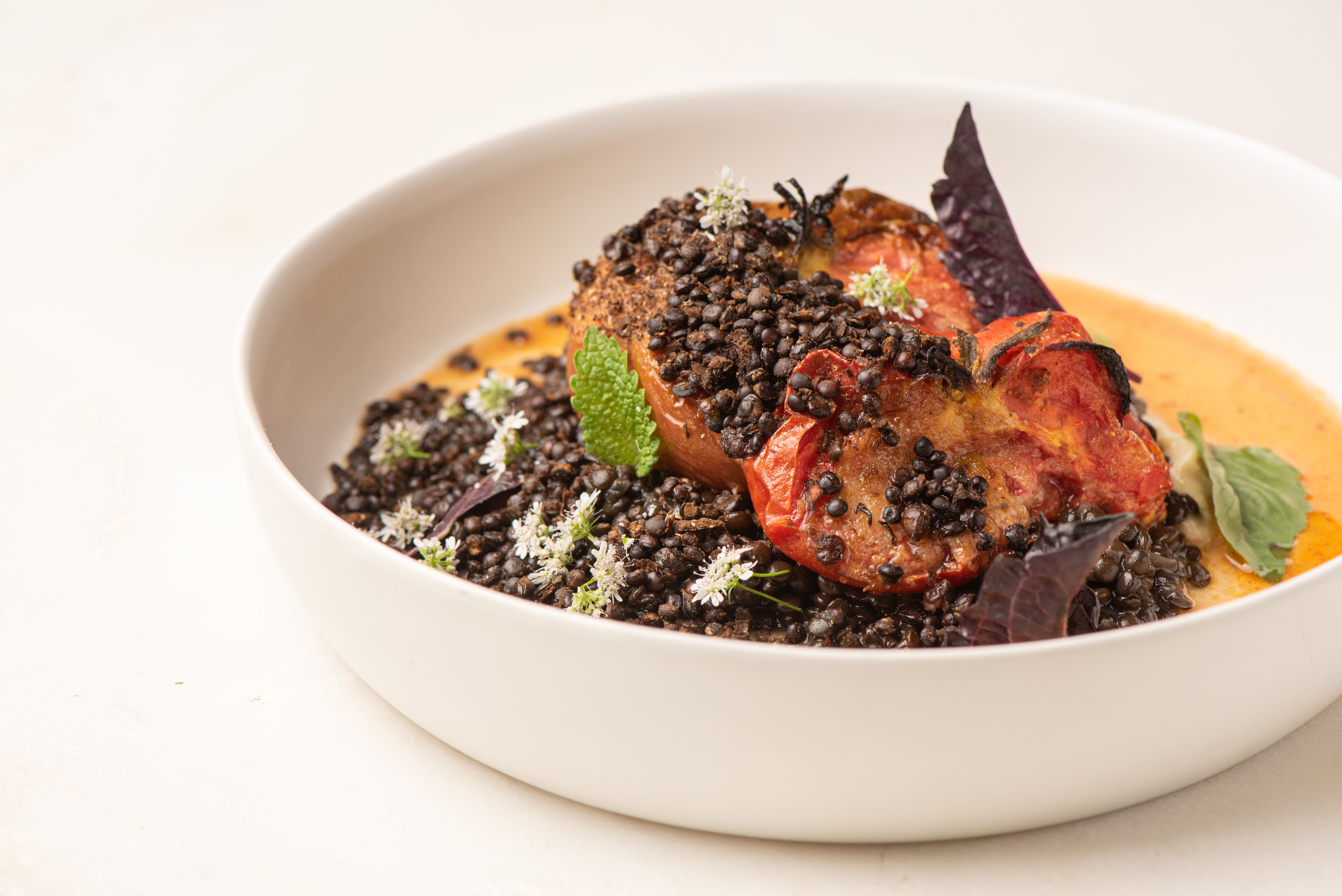 Charred tomatoes with lentils at Varro in Venice.