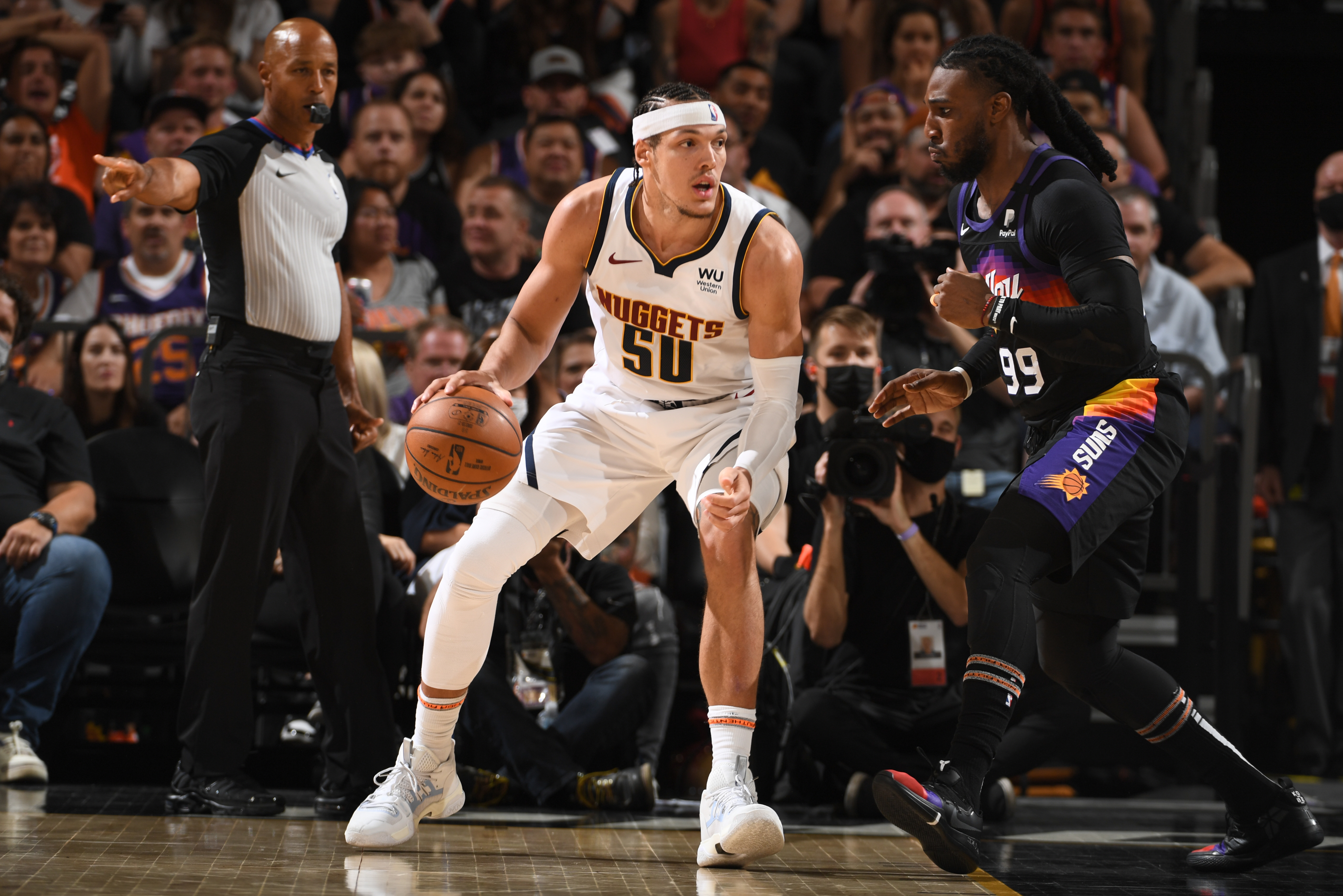 Jae Crowder of the Phoenix Suns plays defense on Aaron Gordon of the Denver Nuggets during Round 2, Game 1 of the 2021 NBA Playoffs on June 7, 2021 at Phoenix Suns Arena in Phoenix, Arizona.