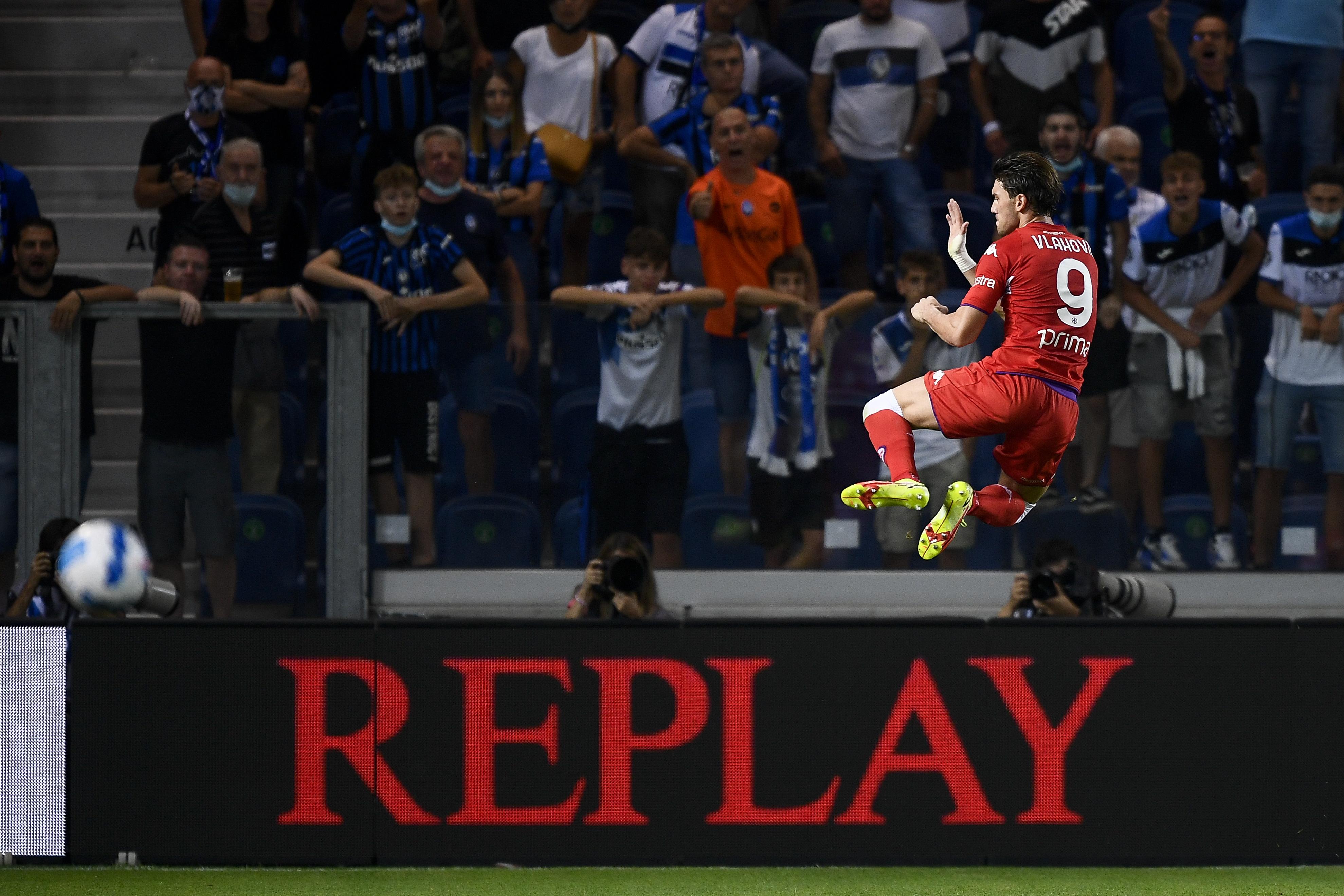 Dusan Vlahovic of ACF Fiorentina celebrates after scoring...