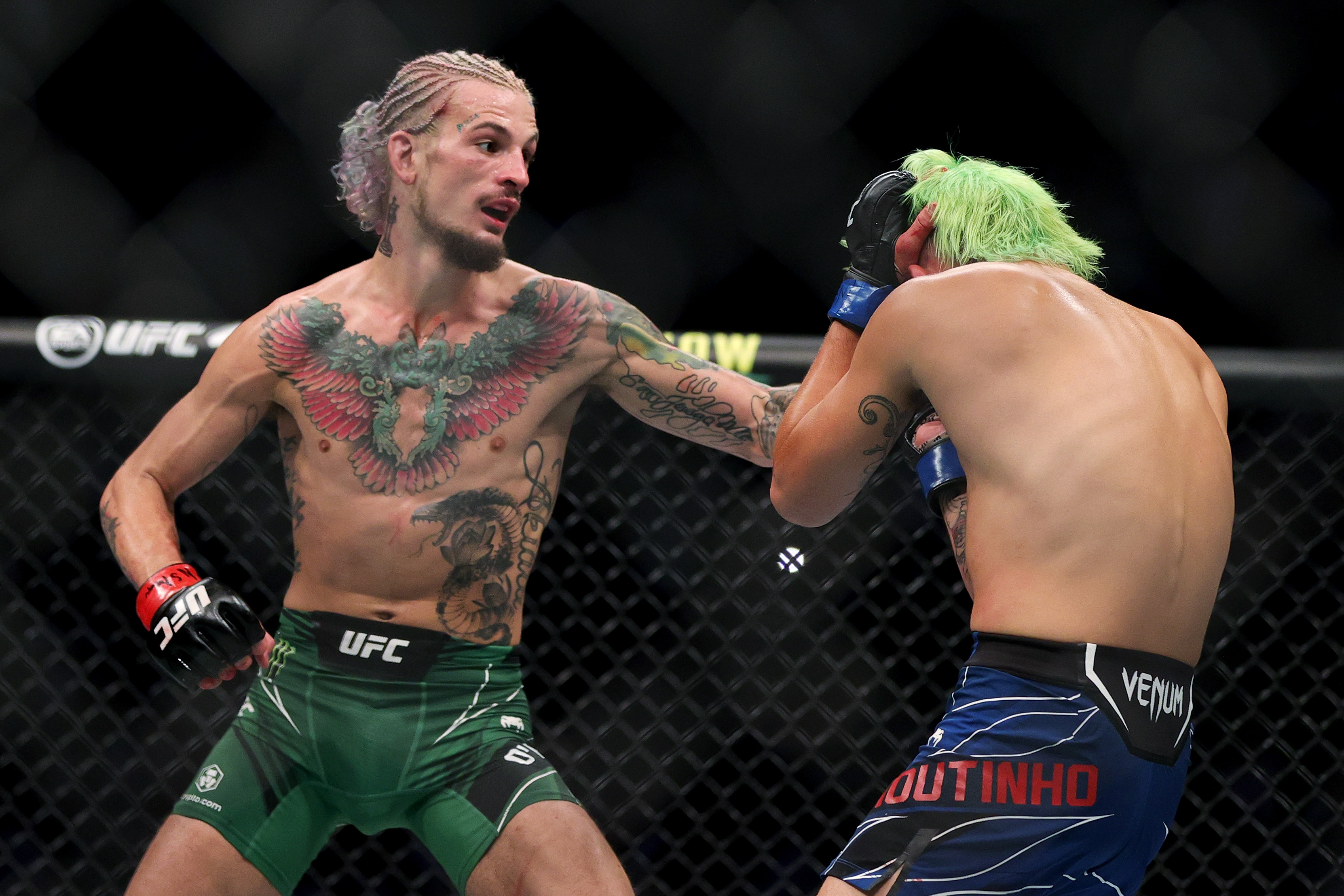 Sean O'Malley lands a left hand on Kris Moutinho at UFC 264 in July.
