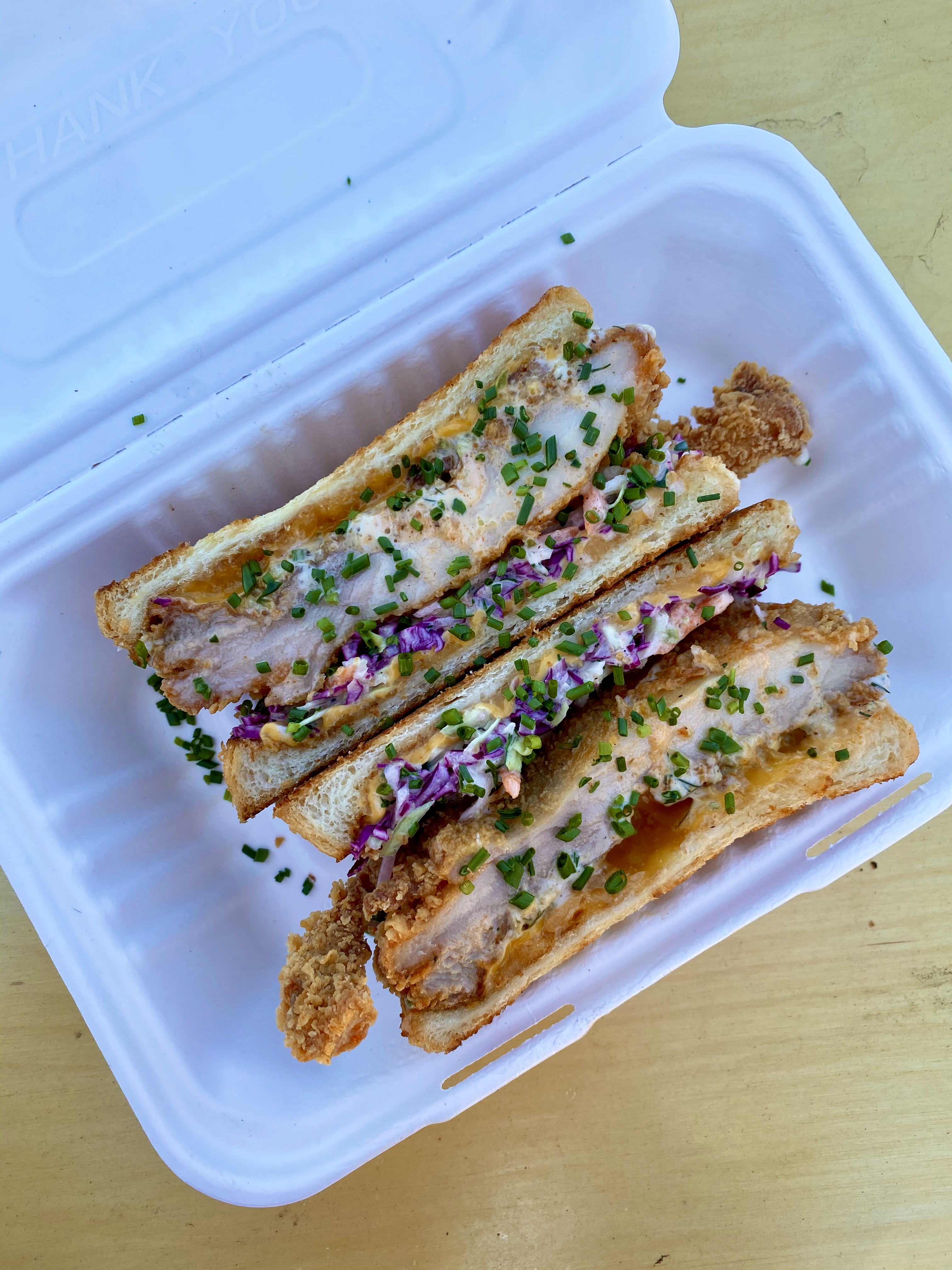 Fried chicken melt at Jojo is american and cheddar cheeses, crystal hot sauce, house ranch, coleslaw, butter toasted shokupan
