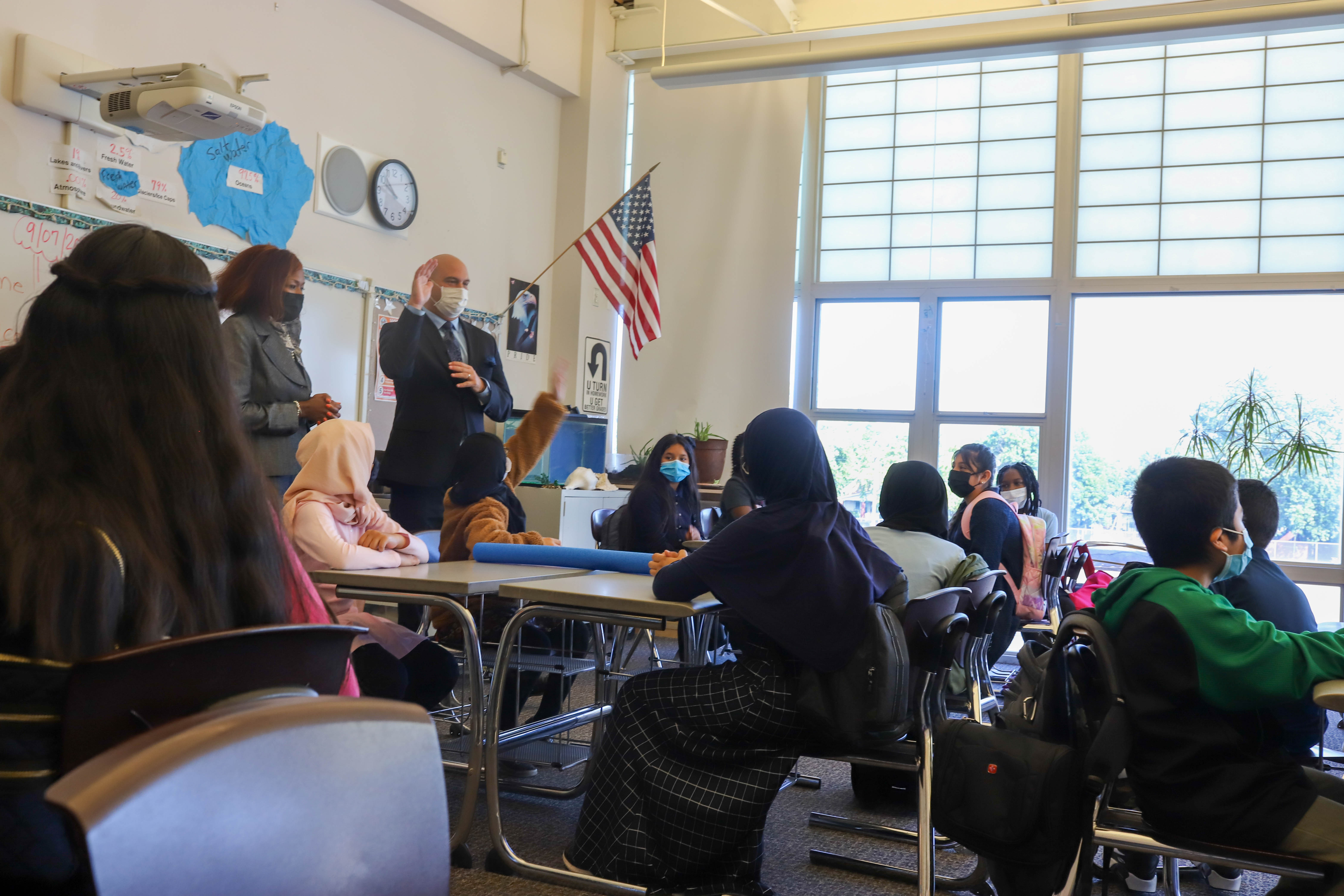 Superintendent Dr. Nikolai Vitti and Detroit Public Schools Board President Angelique Peterson-Mayberry speak with a classroom of full of students.