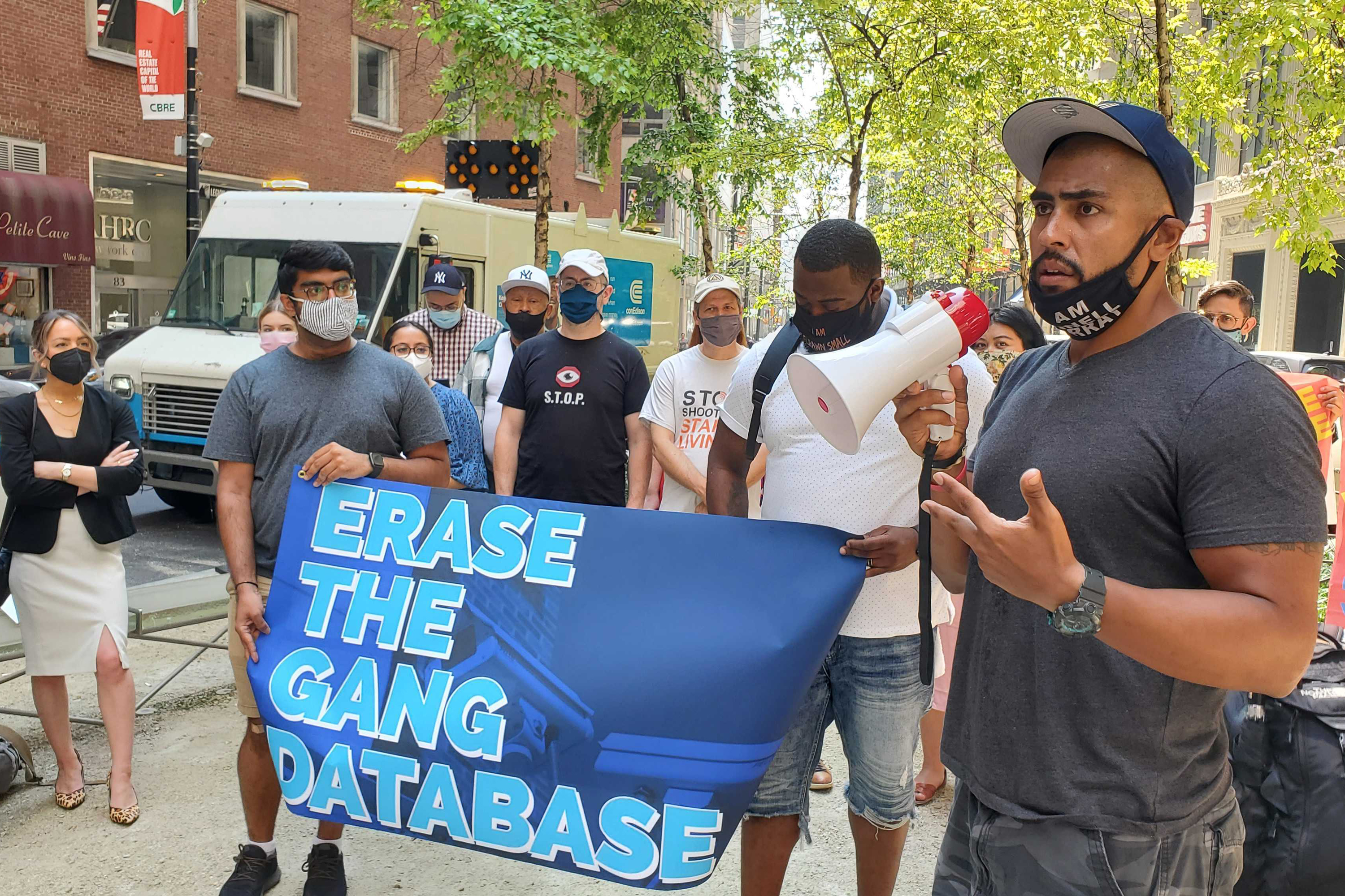 Members of the Grassroots Advocates for Neighborhood Groups & Solutions coalition protest outside of the NYPD's inspector general's office in Lower Manhattan, July 27, 2021.
