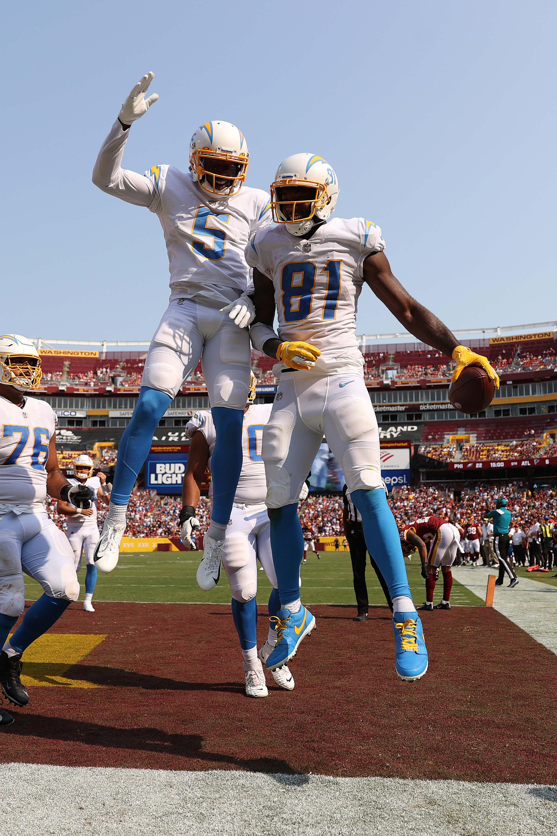 Mike Williams #81 of the Los Angeles Chargers celebrates with teammates after catching a three yard touchdown reception during the fourth quarter against the Washington Football Team at FedExField on September 12, 2021 in Landover, Maryland.