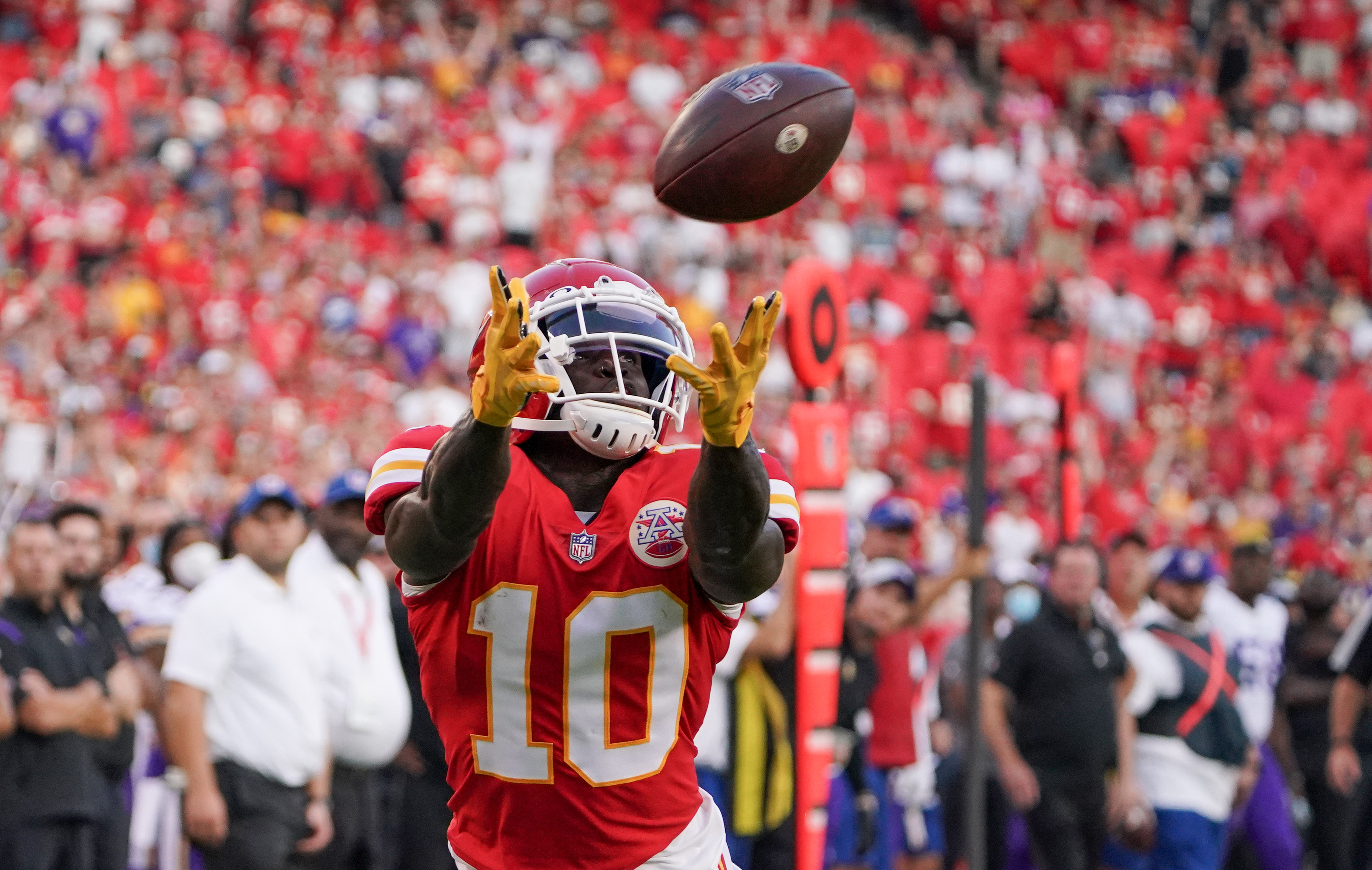 Kansas City Chiefs wide receiver Tyreek Hill (10) catches a pass for a touchdown against the Minnesota Vikings during the first quarter at GEHA Field at Arrowhead Stadium.