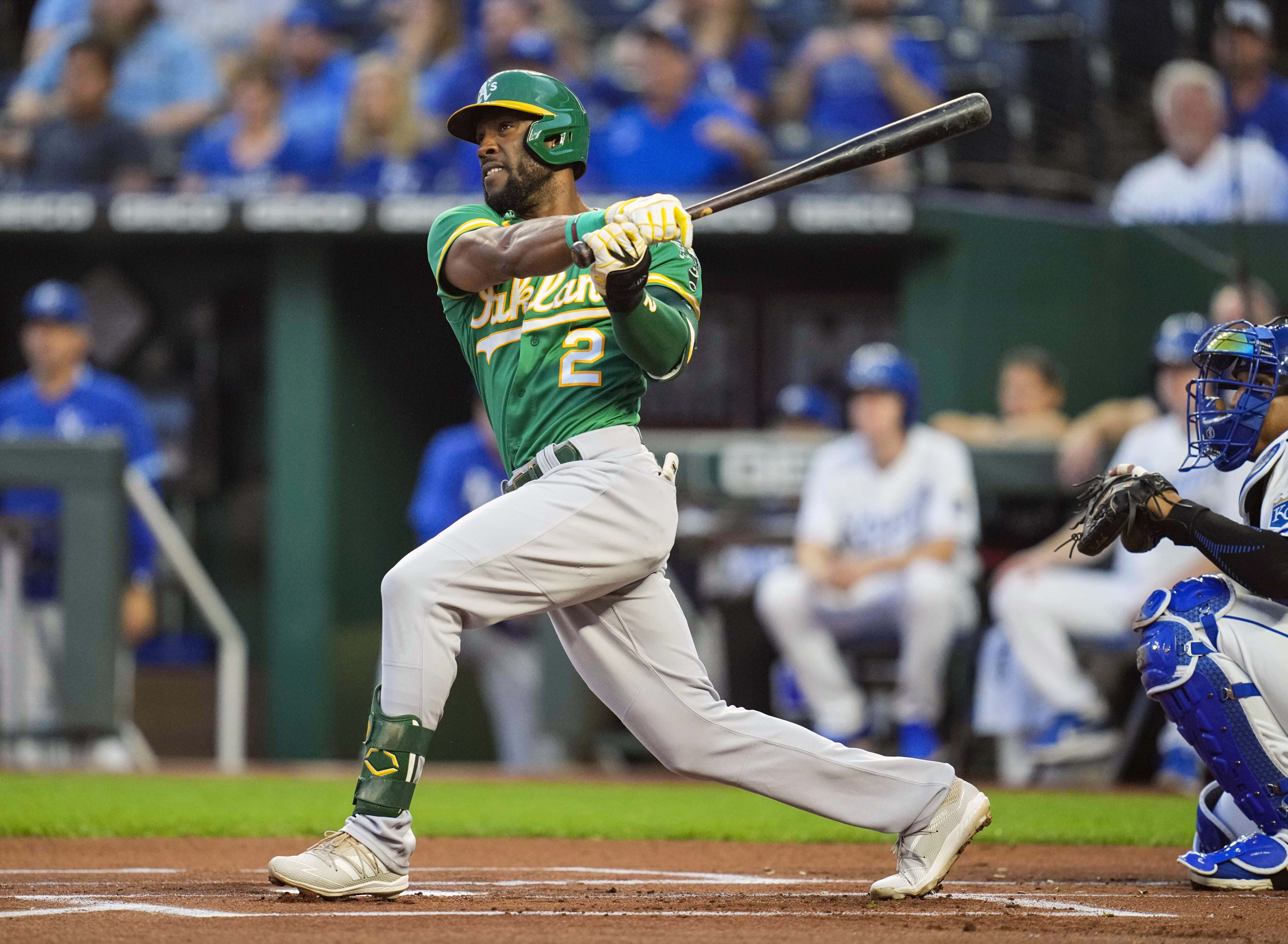 Oakland Athletics center fielder Starling Marte (2) hits a double against the Kansas City Royals during the first inning at Kauffman Stadium.