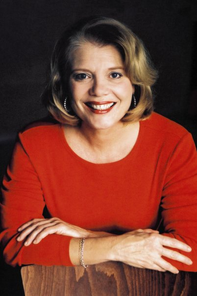 A woman, Dotty Griffith, wearing a red shirt