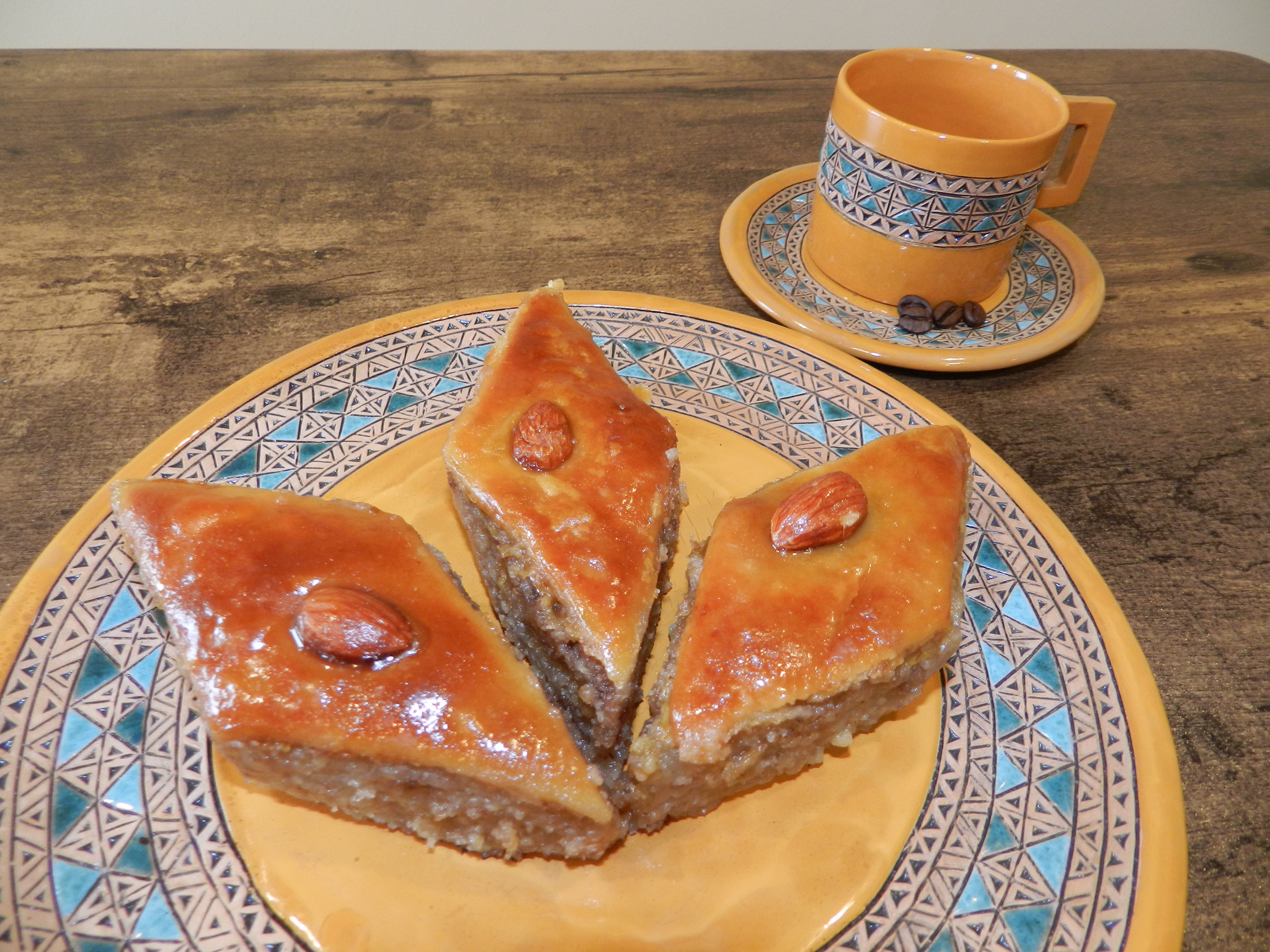 Baklava with walnuts is served on intricately-decorated plates from Armenia